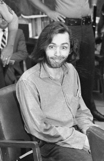 Manson sticks his tongue out at photographers as he appears in a Santa Monica, Calif., courtroom on June 25, 1970.