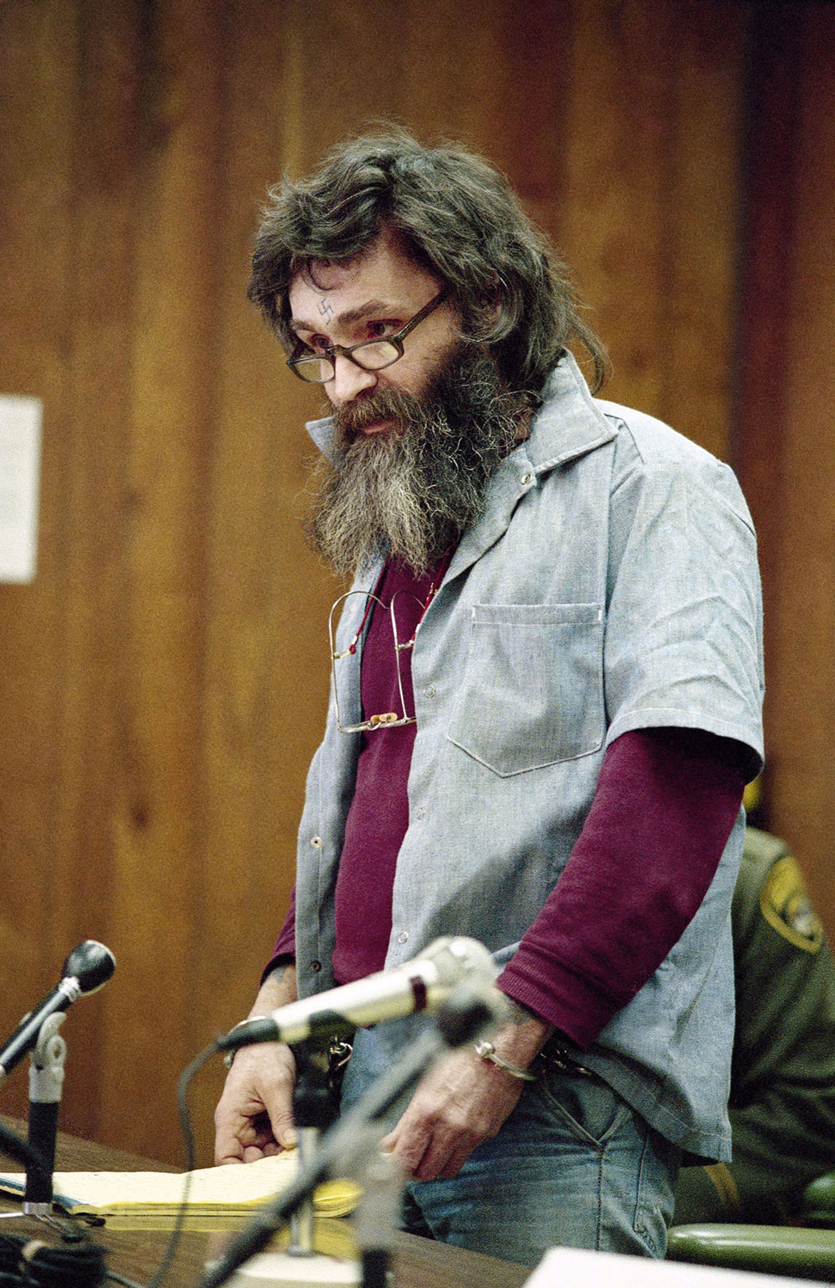 Manson appears at his parole hearing at San Quentin, Calif., in 1985.