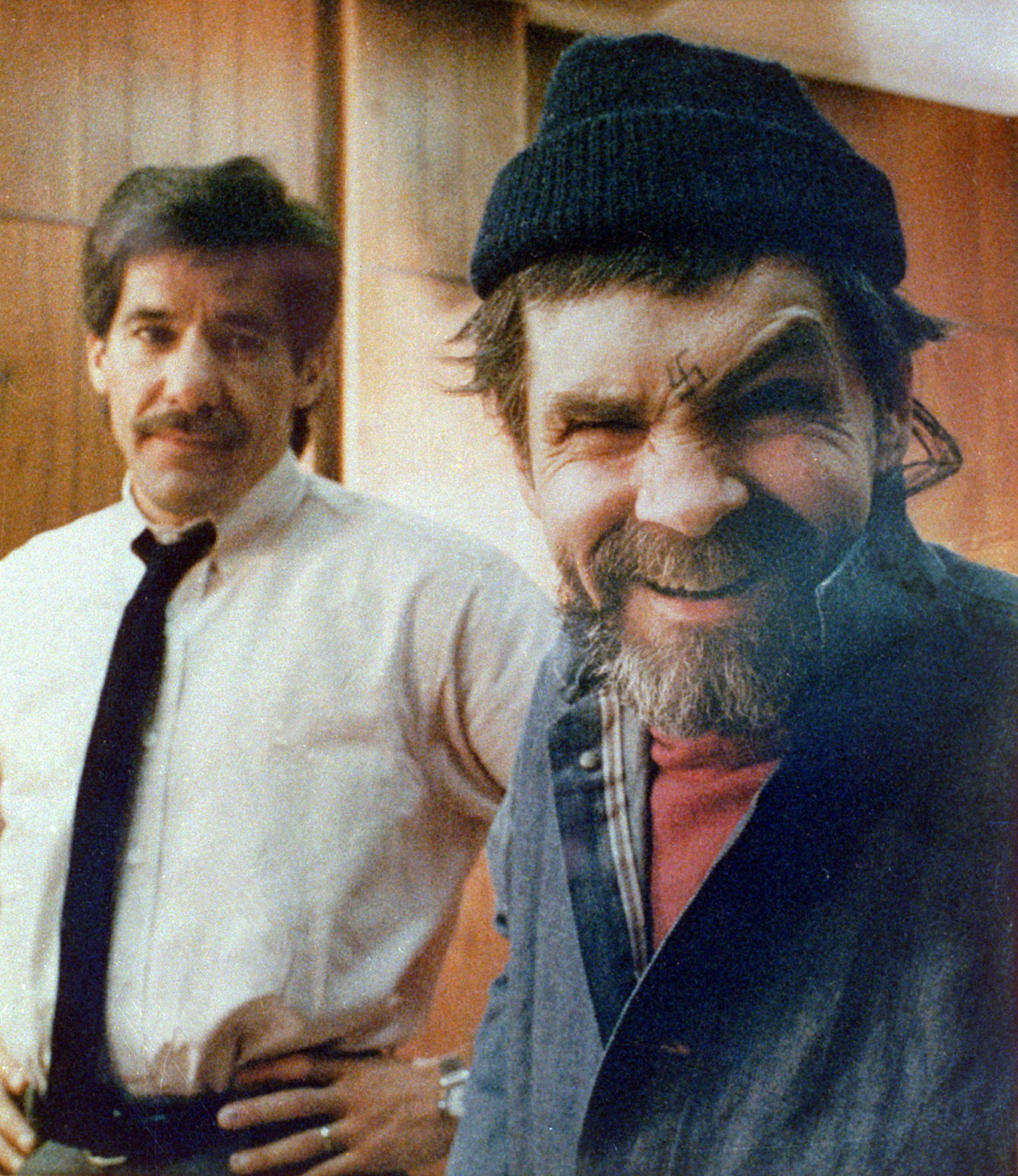 Manson mugs for the camera during a rare interview with reporter Geraldo Rivera at San Quentin Prison in California on March 17, 1988.