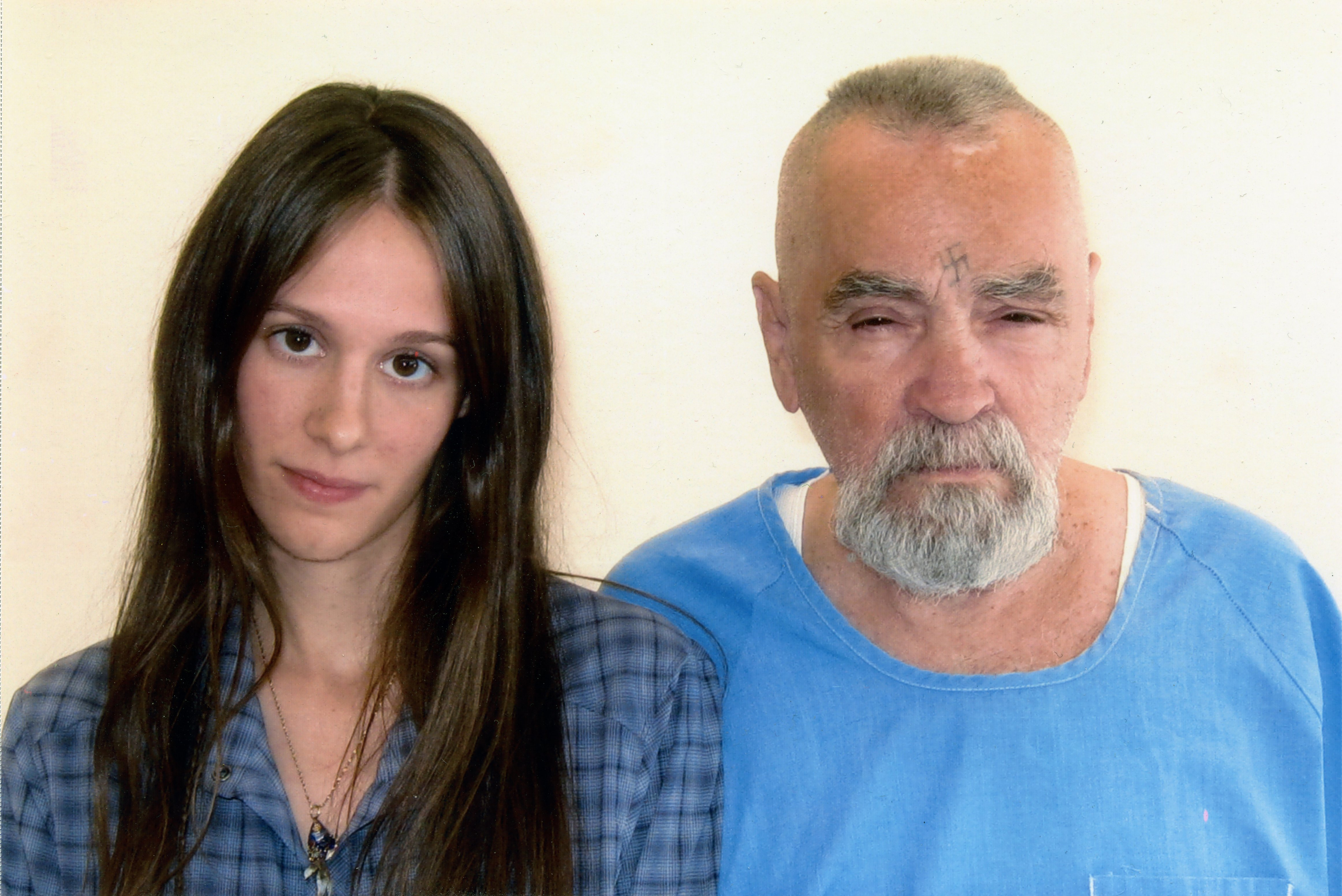 From Left: Afton Elaine Burton and Charles Manson, imprisoned for life for association with a series of murders in the 1960s in Corcoran, Calif. on Aug. 14, 2011.