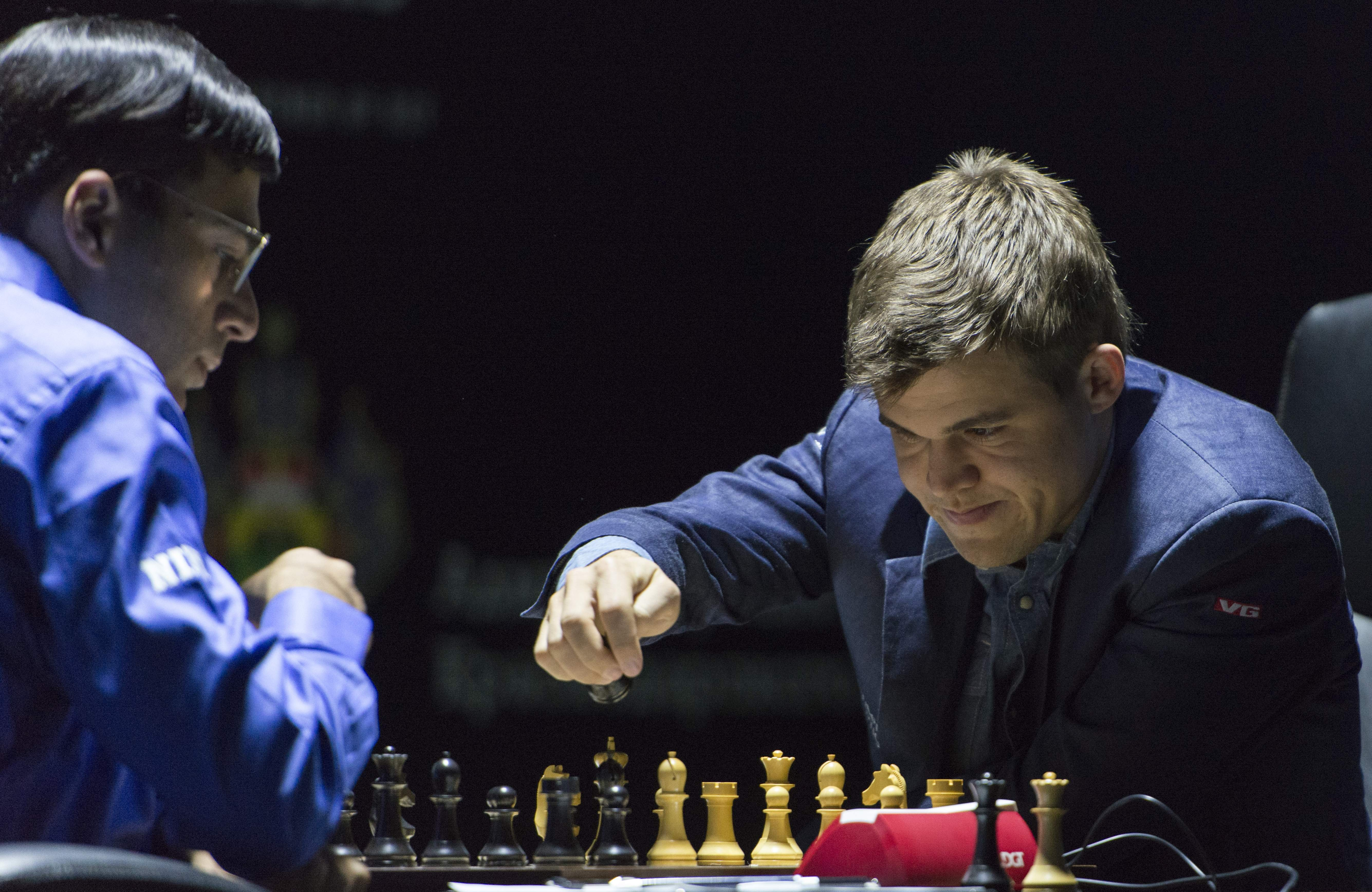 Norway's Magnus Carlsen, currently the top ranked chess player in the world makes a move as he plays against India's former World Champion Vishwanathan Anand at the FIDE World Chess Championship Match in Sochi, Russia on Nov. 9, 2014.