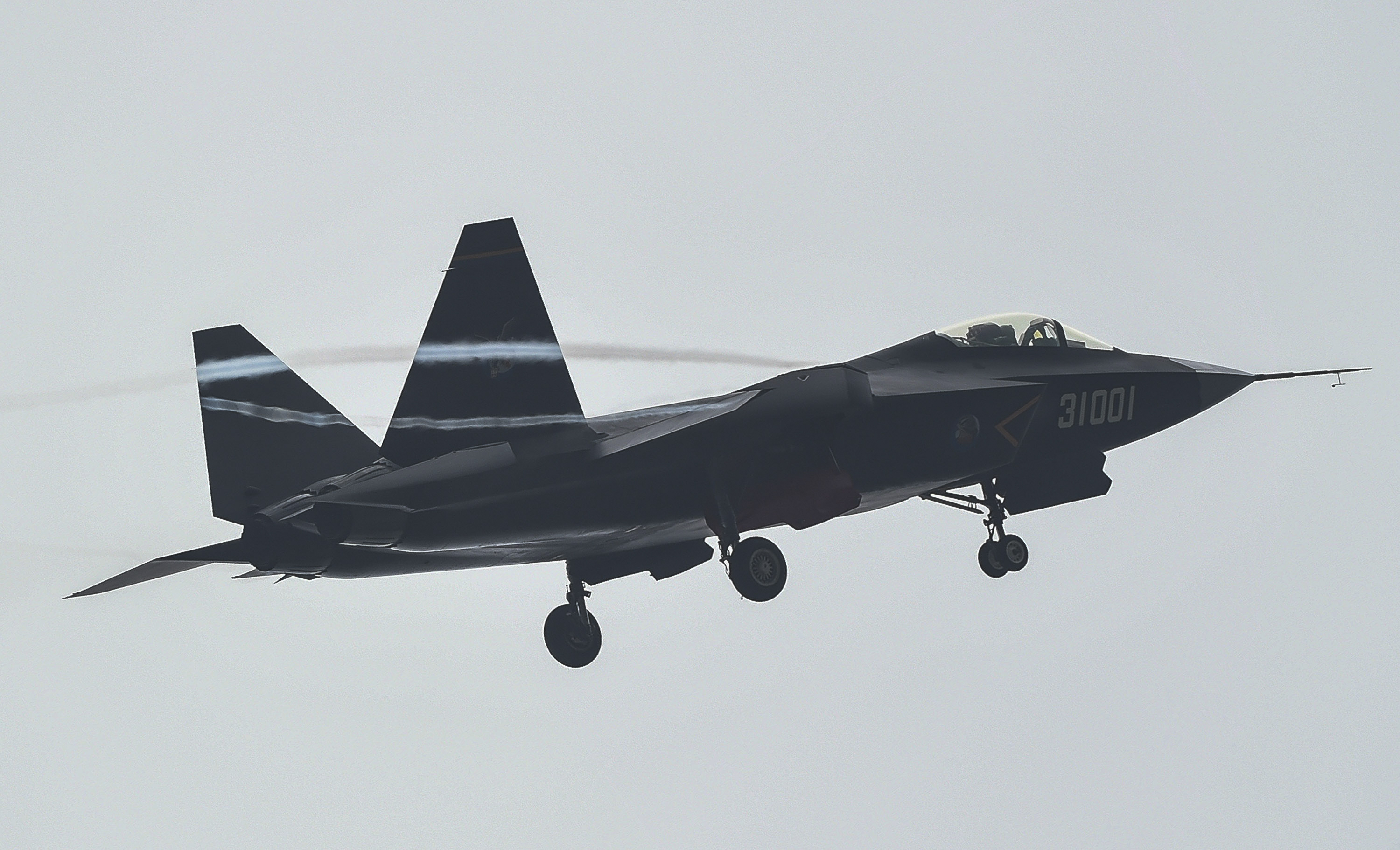In this In this photo provided by Xinhua News Agency, a J-31 stealth fighter takes off for test flight ahead of the China International Aviation & Aerospace Exhibition in Zhuhai, China's southern Guangdong province, on Nov. 10, 2014