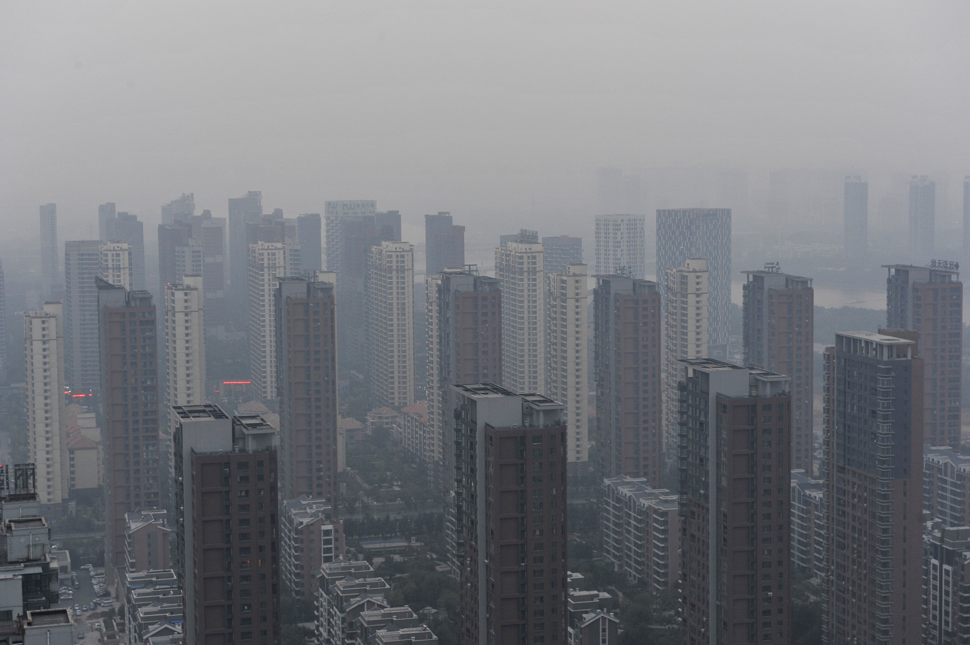 High-rise residential buildings are seen in heavy smog in Shenyang city, northeast China's Liaoning province on Oct. 8, 2014.