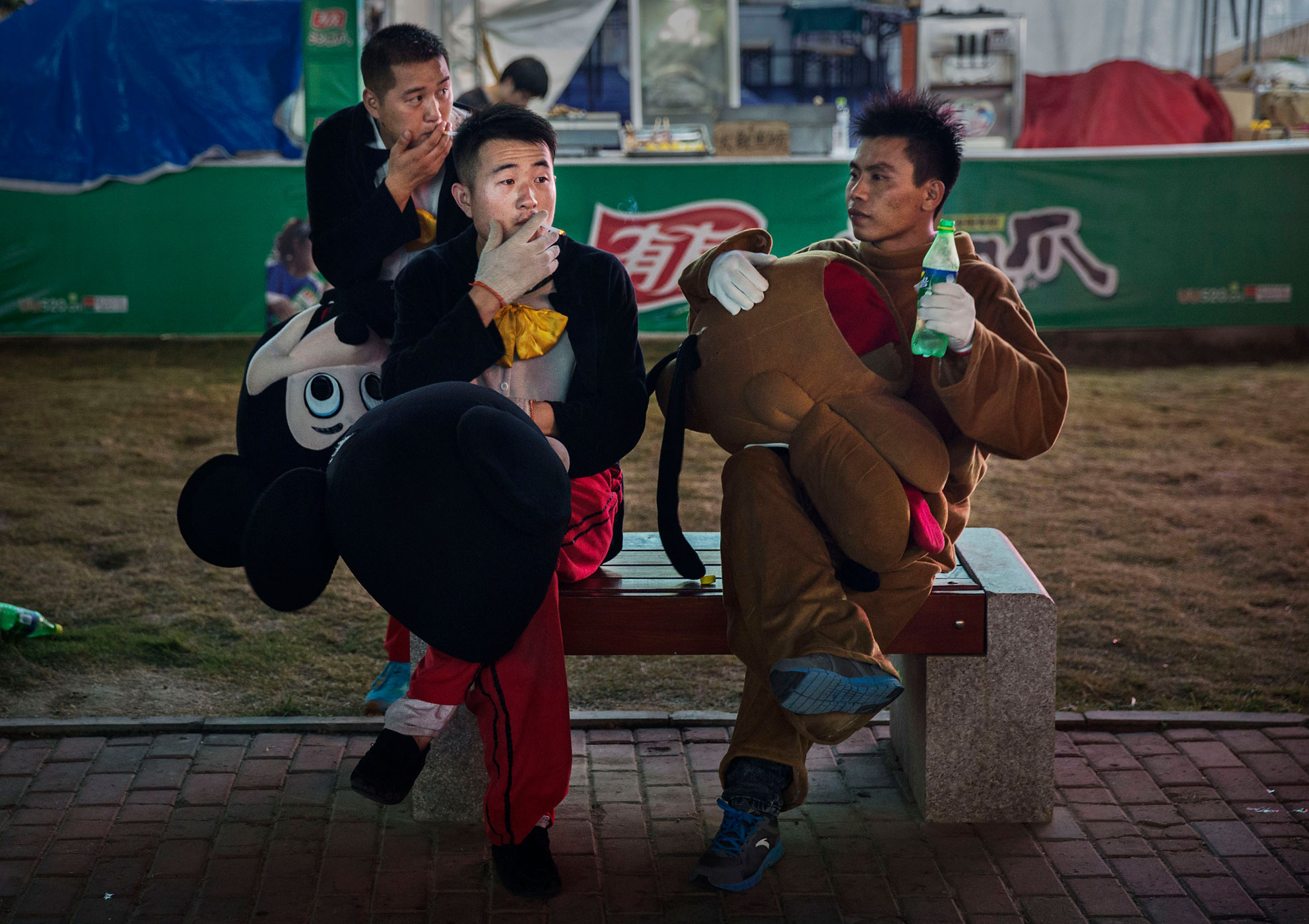Chinese men take a smoke break during the 24th Annual Qingdao International Beer Festival on August 20, 2014 in Qingdao, China.