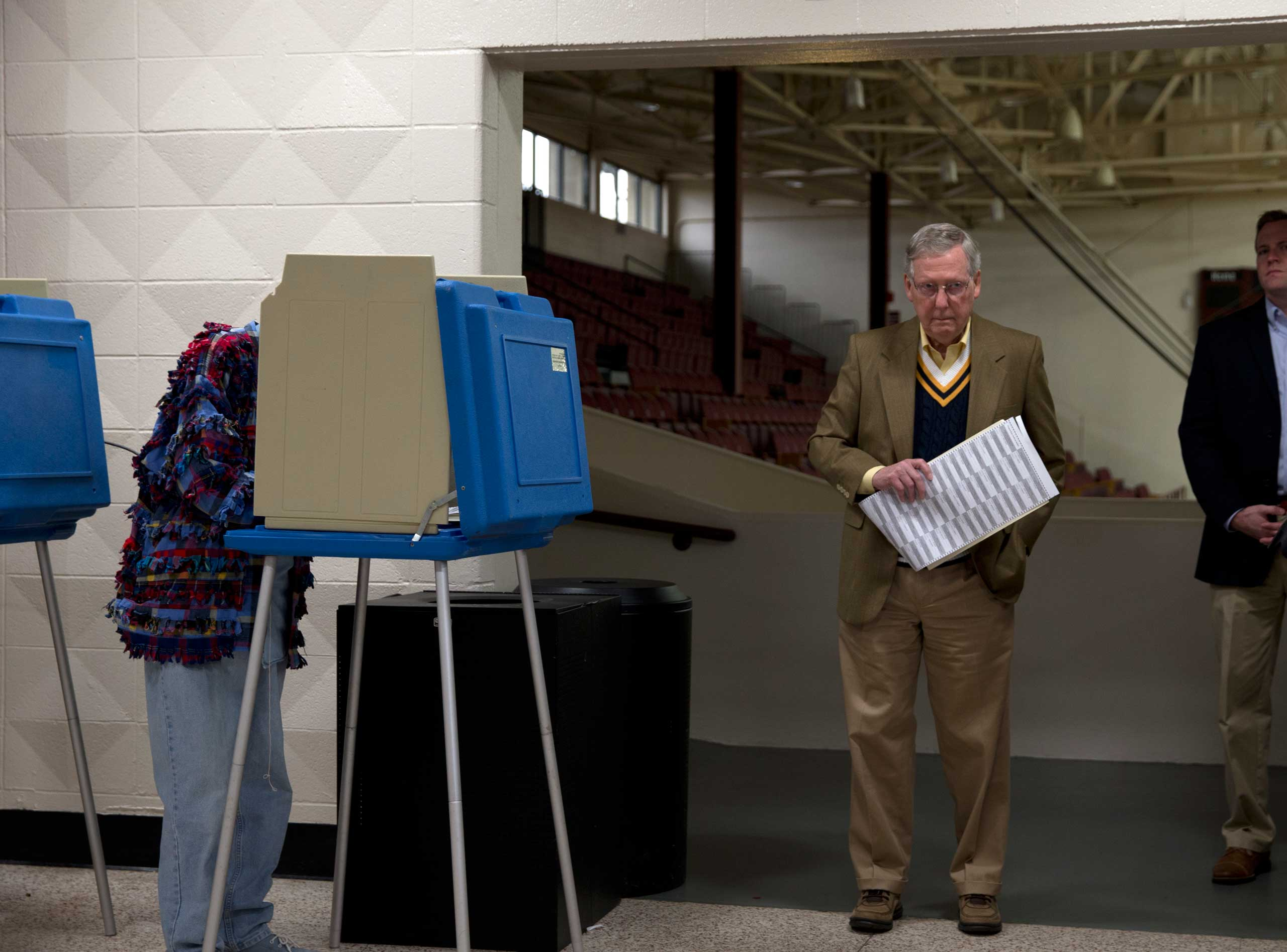 Mitch McConnell, the senior Senator from Kentucky, votes in the midterm election at Bellarmine University Knights Hall Hallway in Louisville, Ky. on Nov. 4, 2014.