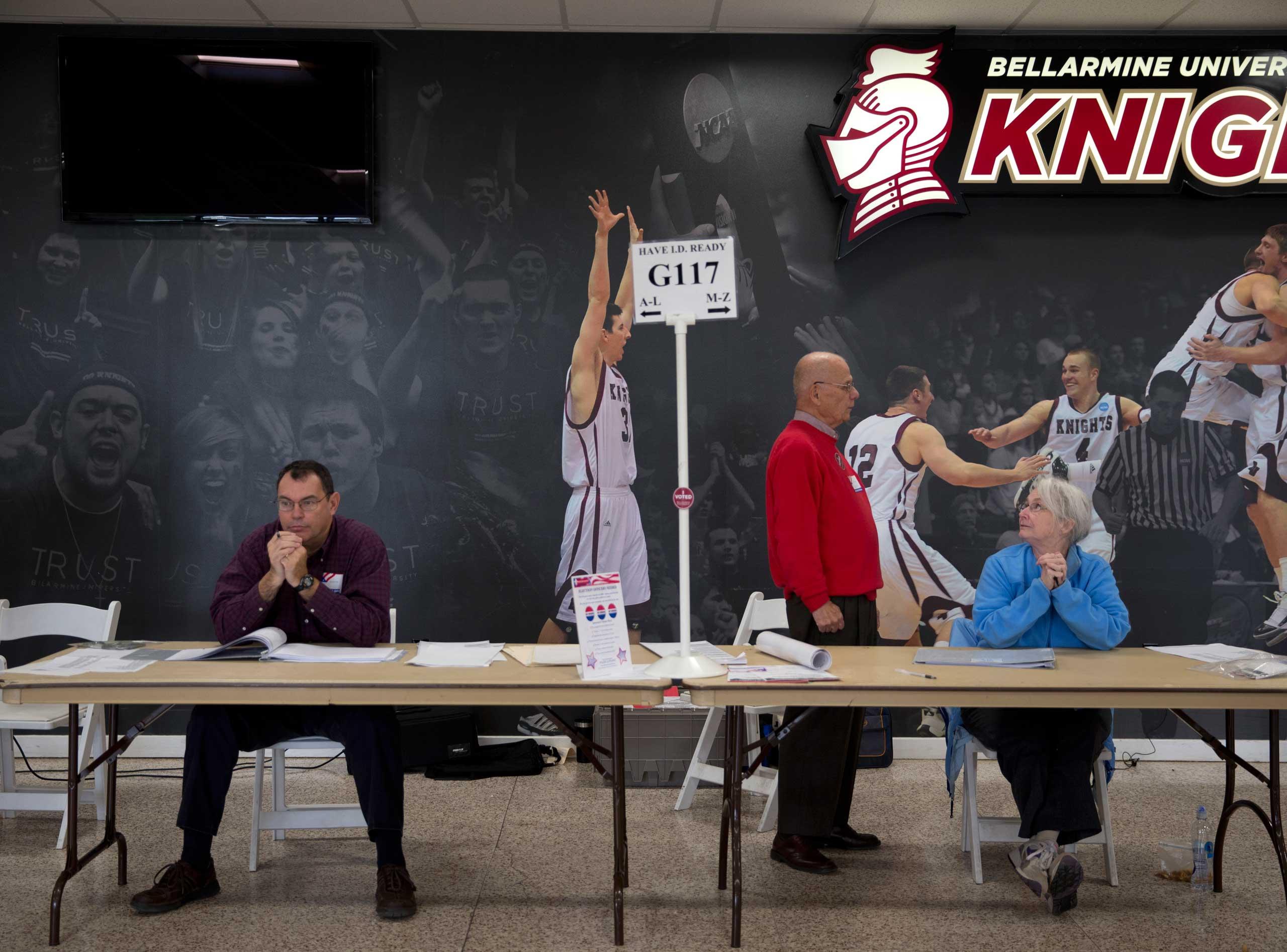 Officials help facilitate midterm election voting at Bellarmine University Knights Hall Hallway, Louisville, Ky. on Nov. 4, 2014.