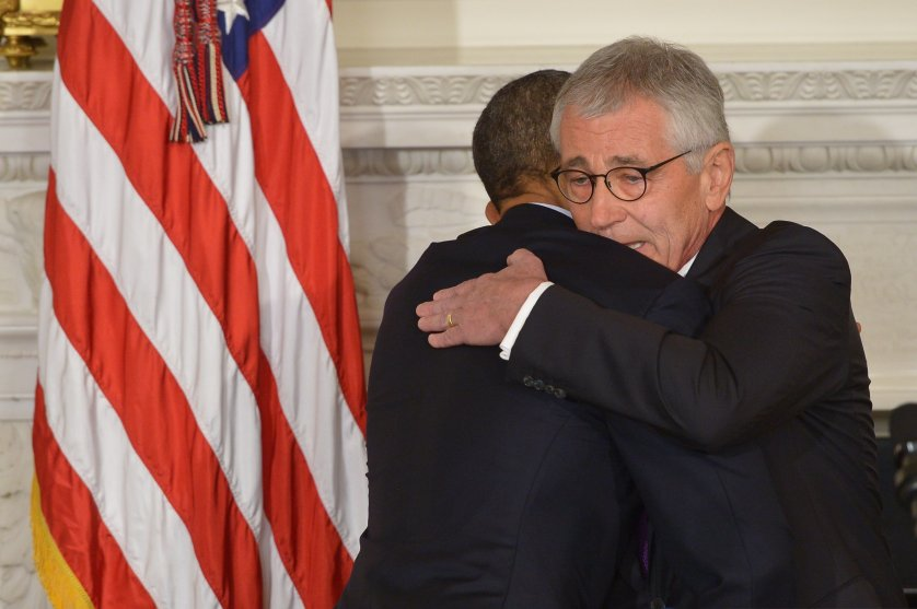 President Barack Obama and Defense Secretary Chuck Hagel embrace during a press conference to announce Hagel's departure at the White House on Nov. 24, 2014 in Washington, DC.