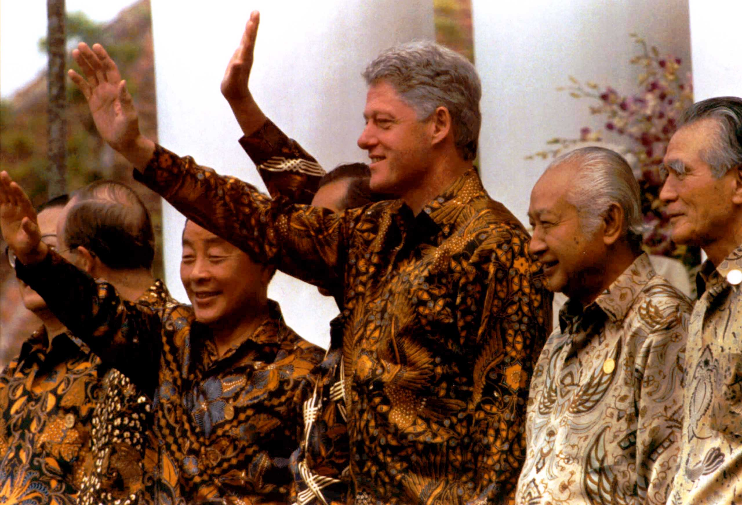 Wearing traditional Indonesian batik clothing, Asia-Pacific Economic Cooperation (APEC) leaders wave during a photo session prior to their meeting in Bogor, Indonesia in 1994.