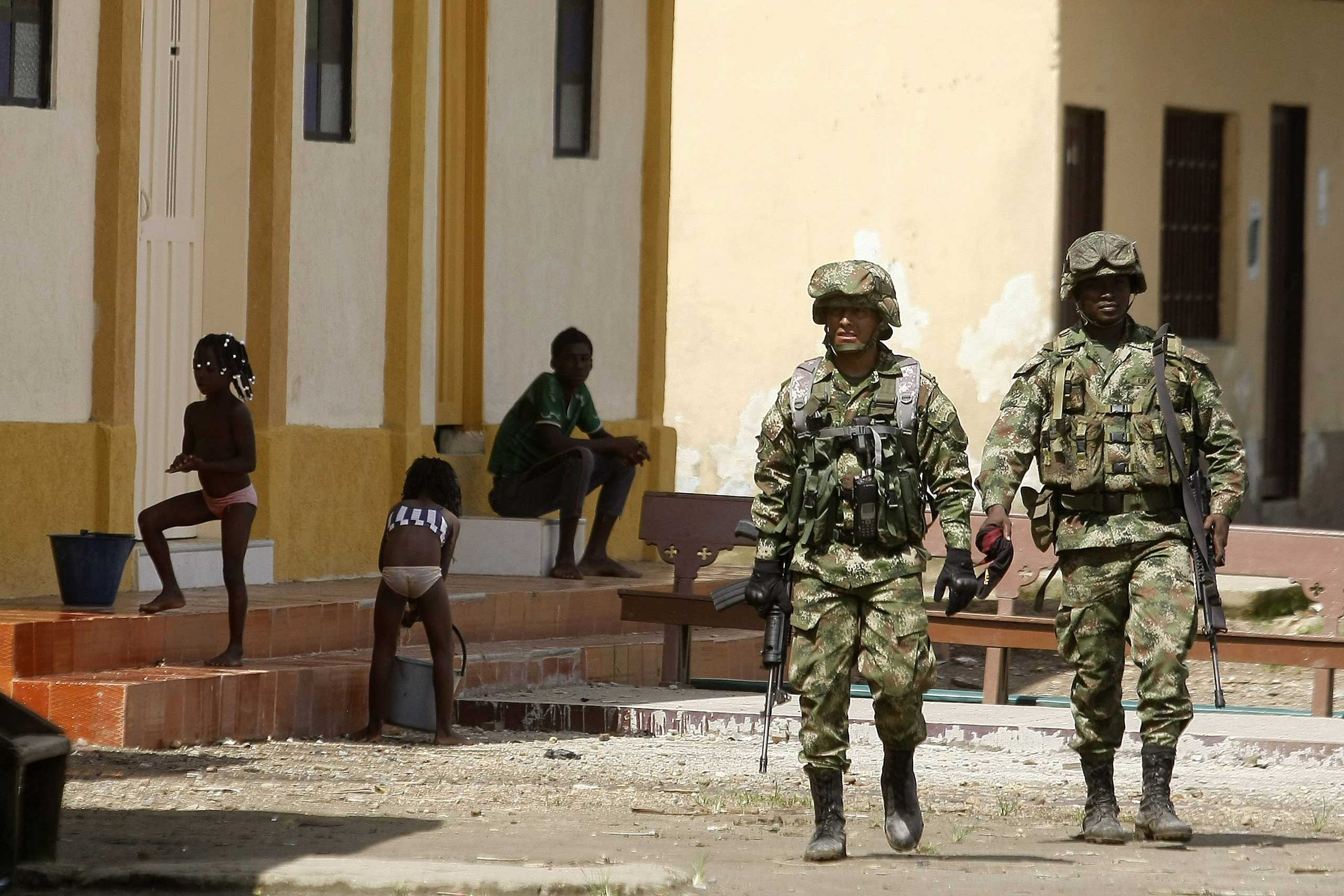 Members of the Colombian Army patrol the sites of Las Mercedes towship, Choco Department, west of Colombia, on Nov. 18, 2014.
