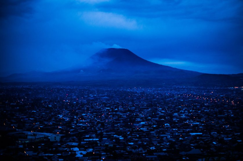 The city of Goma lies at the foot of Mount Nyiragongo, an active volcano situated around 20km from the city, as seen in the evening of November 1, 2013 in the east of the Democratic Republic of the Congo. Mount Nyiragongo last erupted in 2002, destroying around 15% of the city, leaving some 120,000 people homeless.