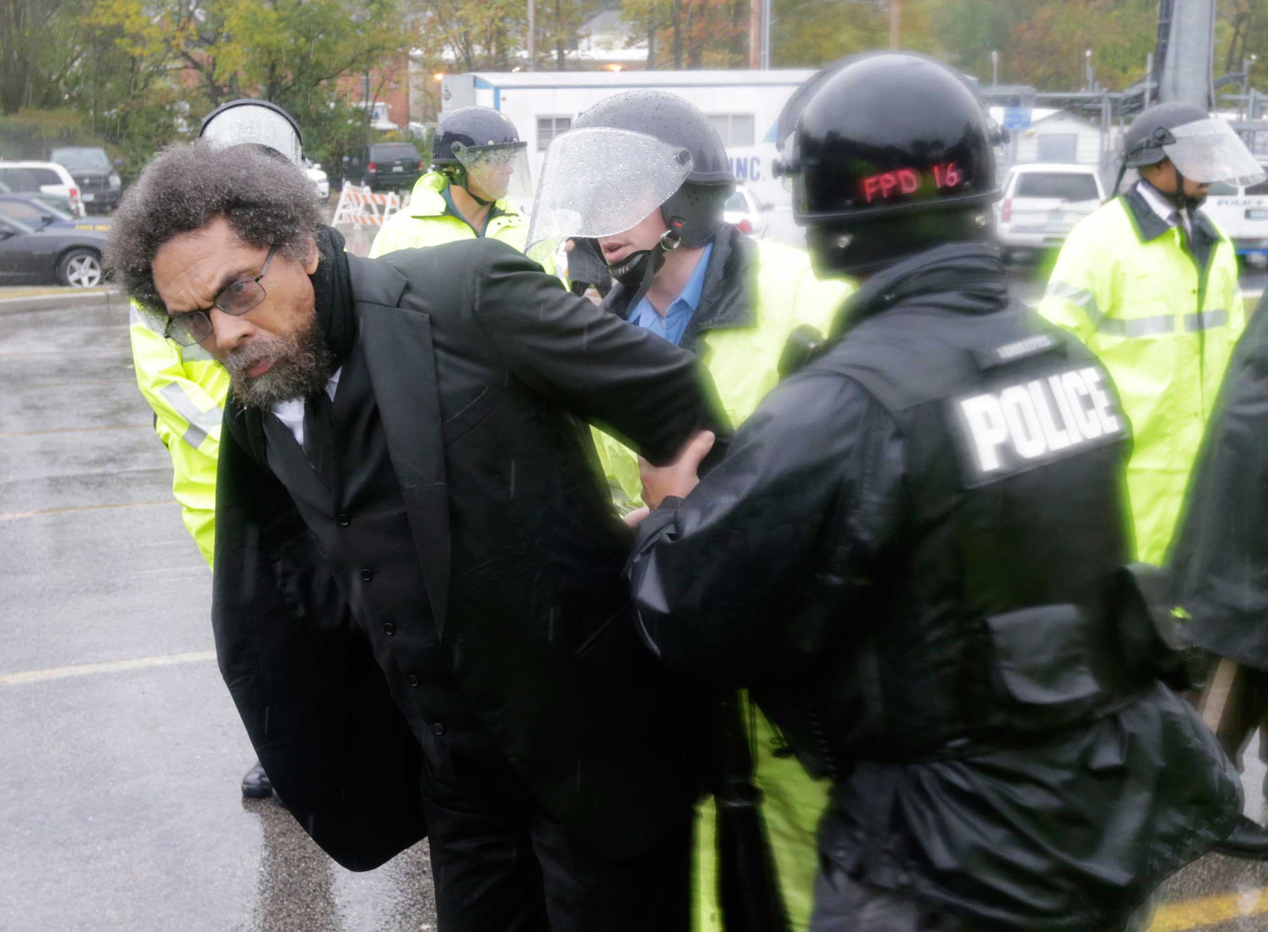 Academic Cornel West is taken into custody after performing an act of civil disobedience at the Ferguson, Mo., police station on Oct. 13, 2014.