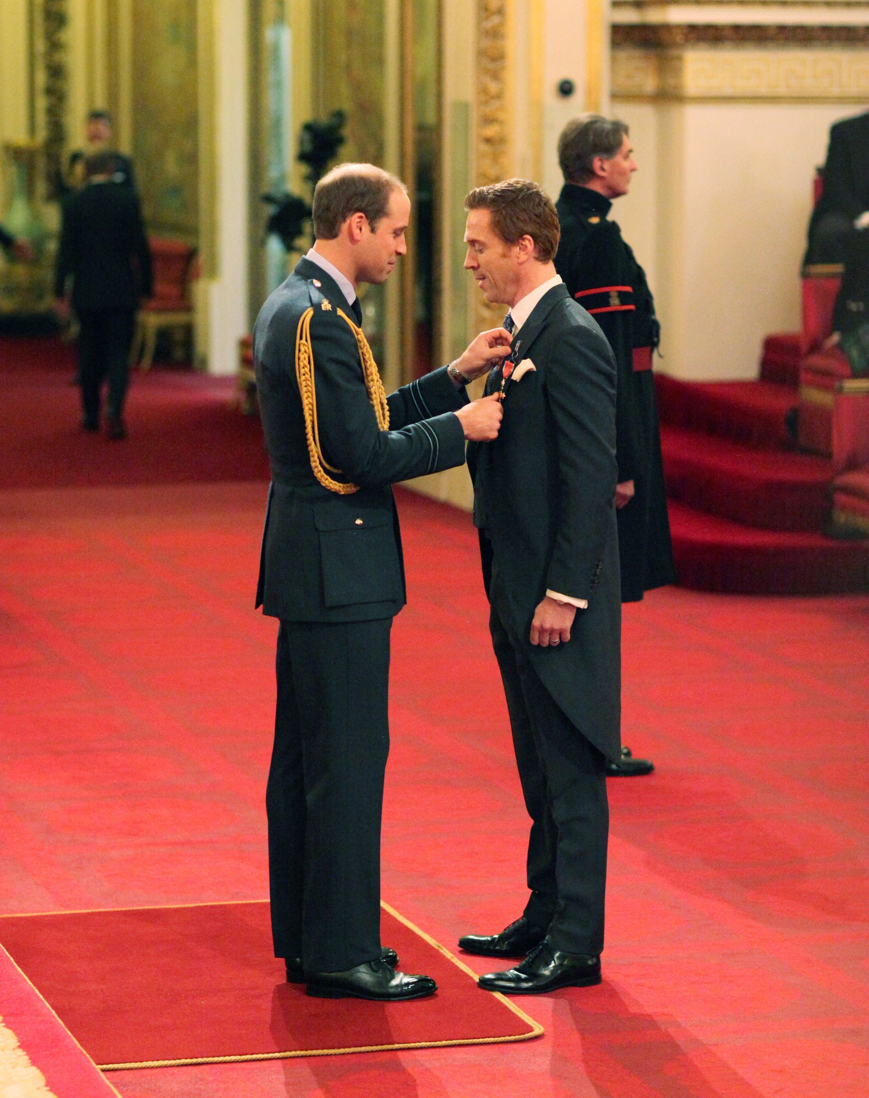 Investitures at Buckingham Palace. Damian Lewis from London is made an Officer of the Order of the British Empire (OBE) by the Duke of Cambridge during an Investiture ceremony at Buckingham Palace on Nov. 26, 2014.