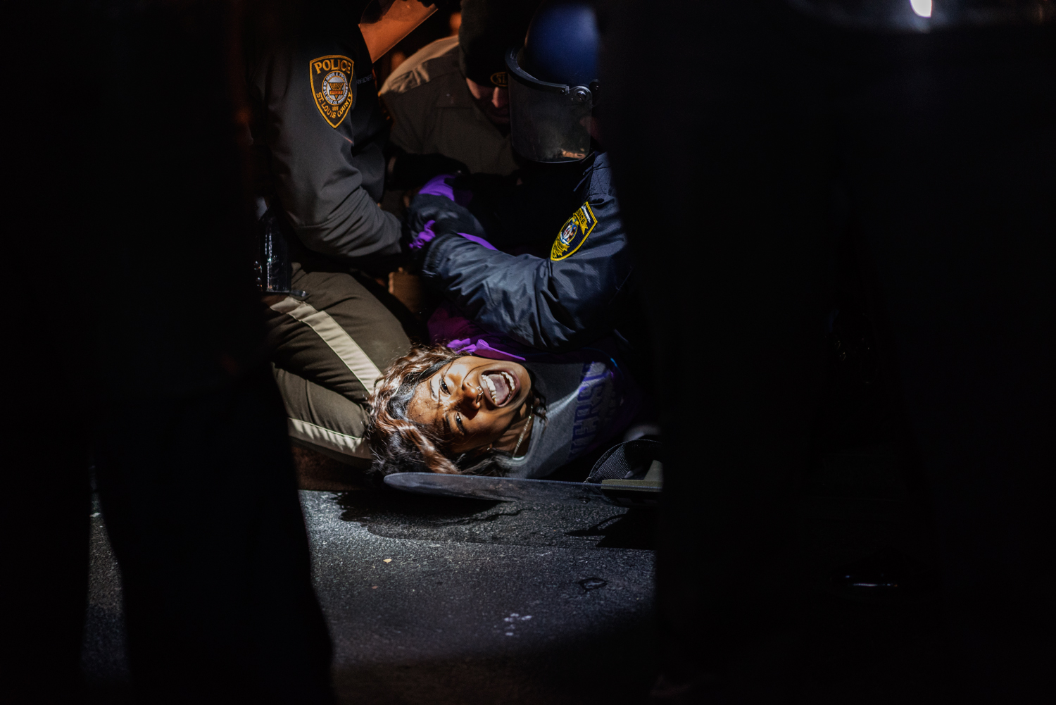 Dasha Jones, 19, is arrested for unlawful assembly during a protest ahead of the grand jury decision in the case against Darren Wilson, who shot unarmed black teenager Michael Brown, outside the Ferguson Police Department in Ferguson, Mo. on the evening of Nov. 20, 2014.