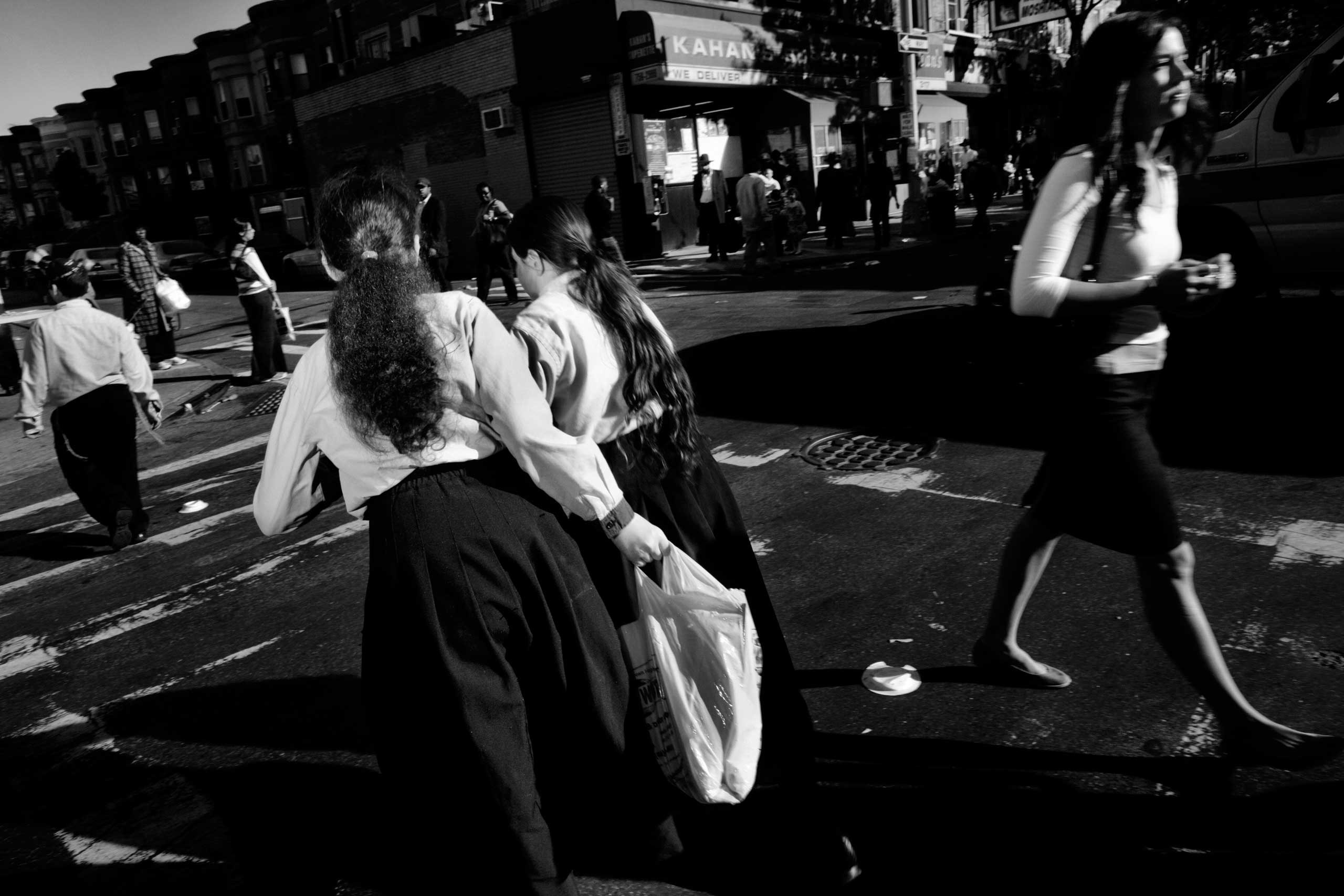 A crowded street on a Friday evening. Women rush home before the beginning of Shabbat. Crown Heights, Brooklyn. Oct. 2010.