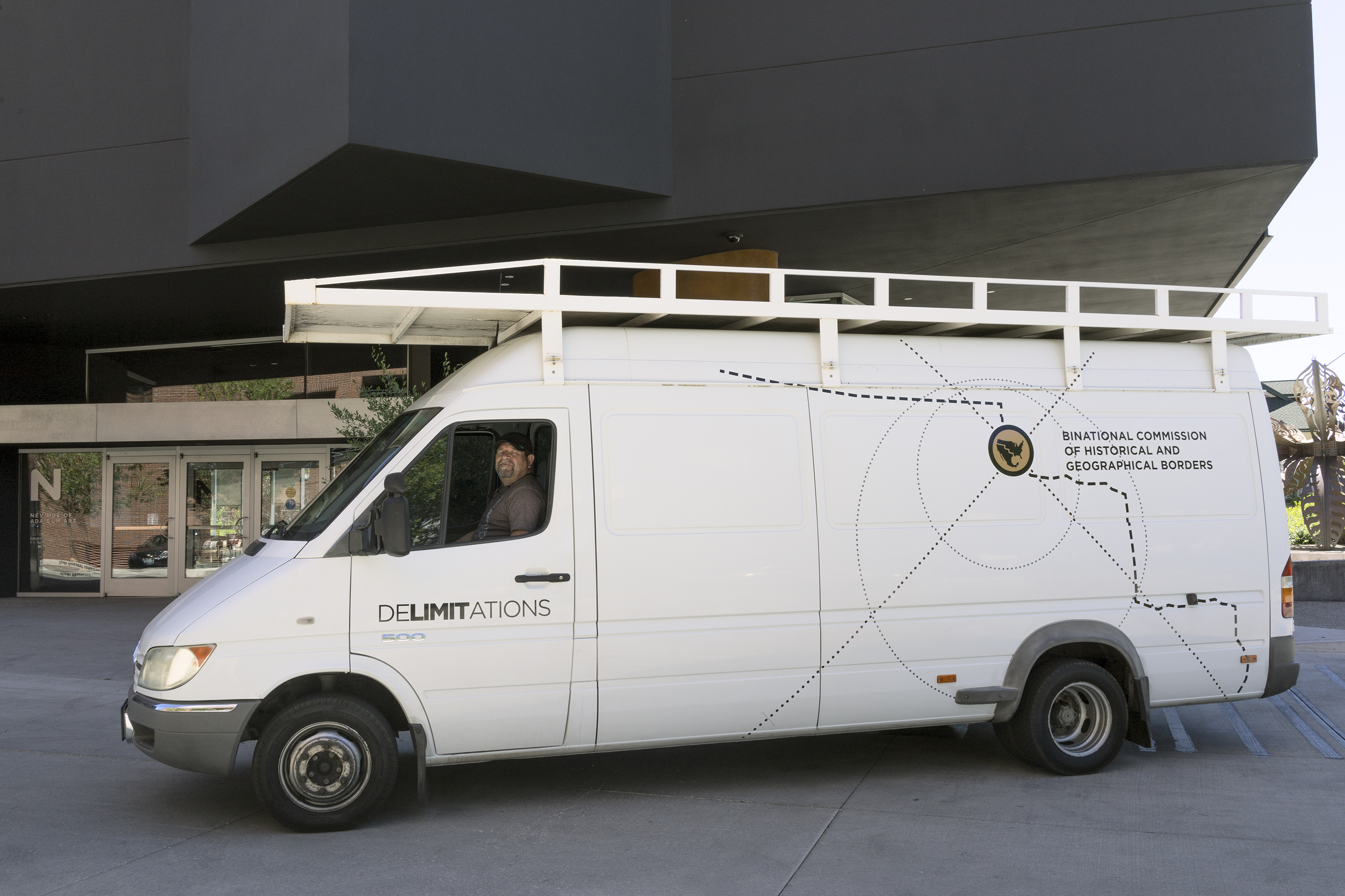Marcos Ramirez ERRE drives the Delimitations van in front of the Nevada Museum of Art.