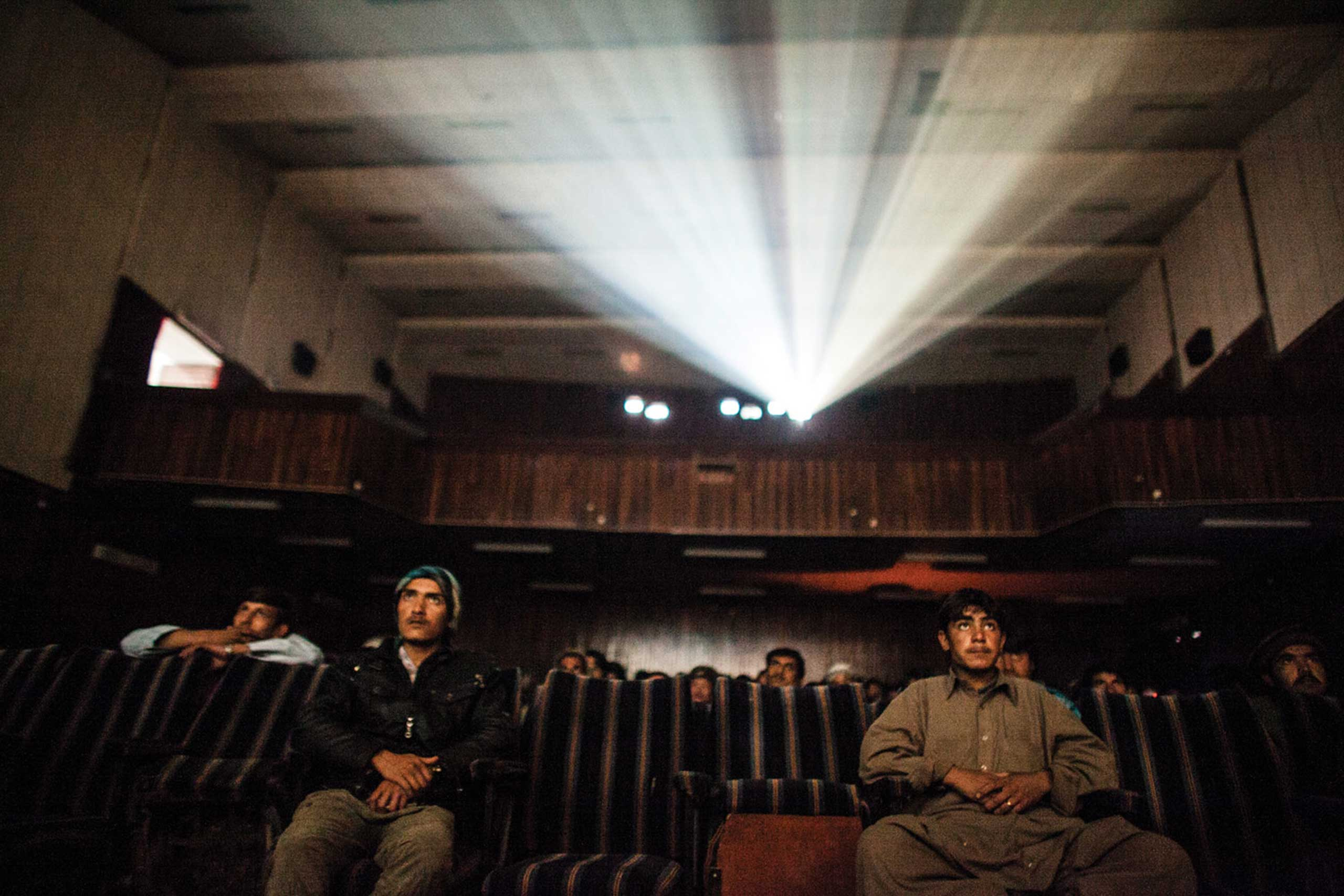 """""""Jonathan Saruk's <i>The Forbidden Reel</i> shows a delicate sliver of life in a country that is notorious for war images. The book is intimate. It allures you into a private place that is usually shrouded in darkness. Saruk's passion for the project is evident in the work. He documents the theaters of Kabul, the projectionists, the screens, and the film itself. But most importantly, Saruk documents the moviegoers. This work provides very important insight into the life of young people in Kabul, through a lens that doesn't involve war or poverty.                                                                      It's an escape from reality for the reader and for the subjects of the pictures - as movies were intended to be.""""                                                                       -Marisa Schwartz, Associate Photo Editor, <i>TIME.com</i>."""