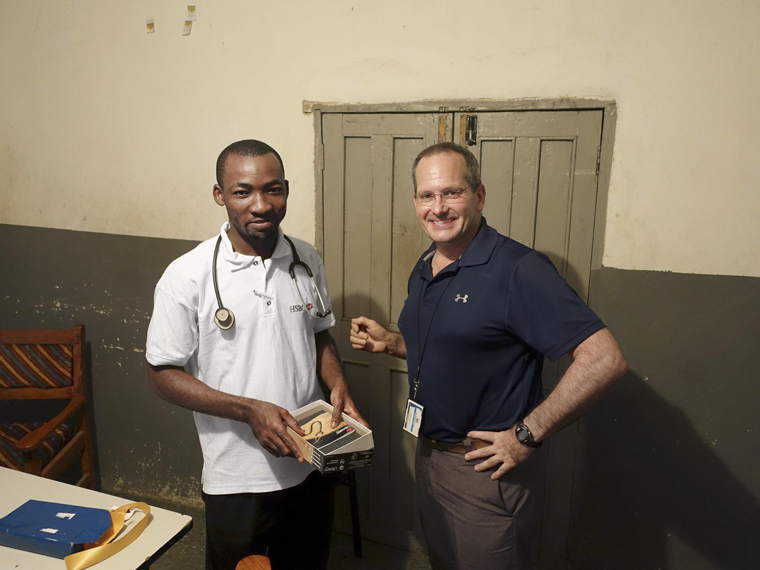 Redd, right, with local medical student Francis Abu Bayor.