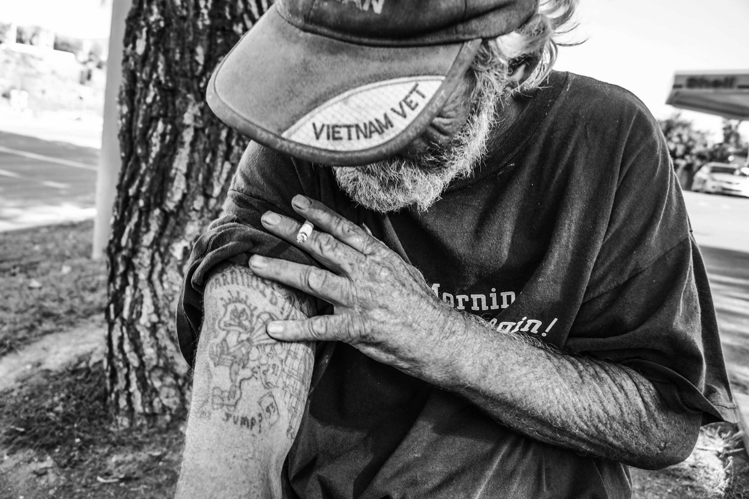 Sept. 24, 2014. Temple Street, Pomona, Calif.                                                               Rodney Farmer shows his tattoo that he got in the military. It is a parachute jumper.  This tattoo represents who I was and what I had to do for my country,  Farmer said.