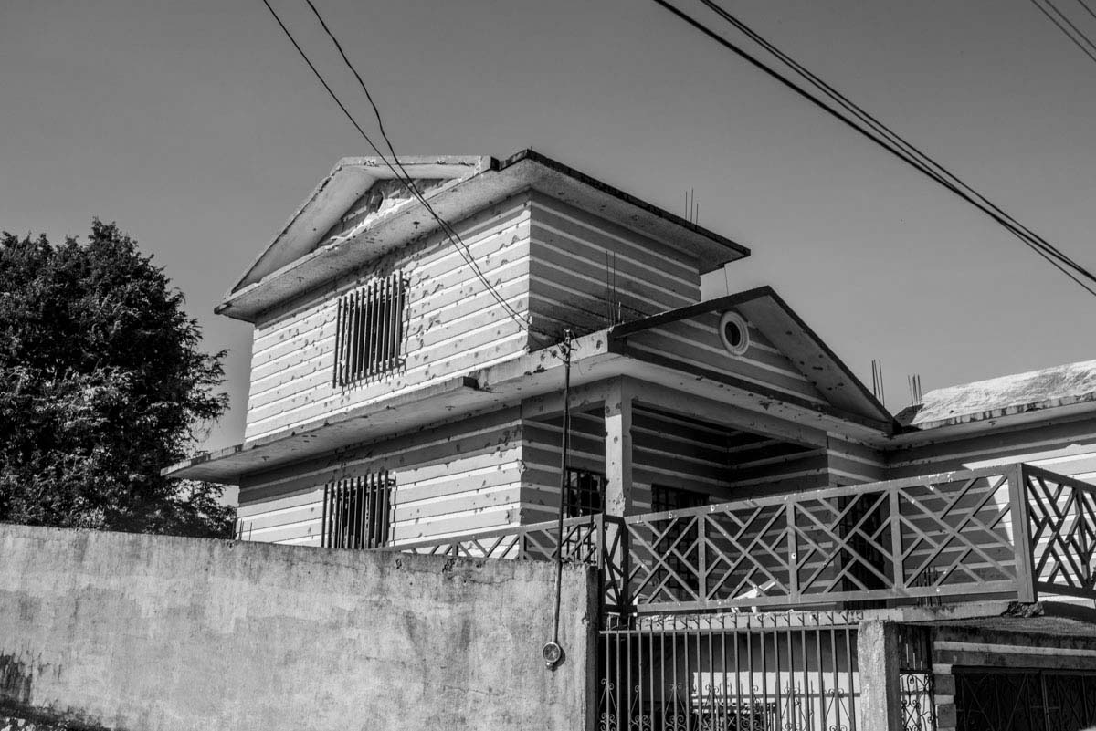 A bullet-ridden house, a vestige of Mexico's drug war, was damaged during a confrontation between local drug gangsters and the federal police.