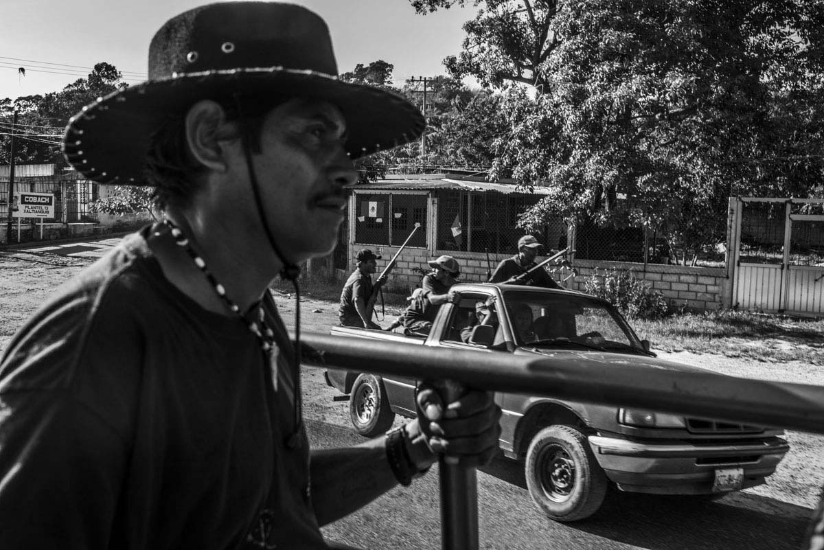 Community police patrol the violent streets of Xaltianguis.