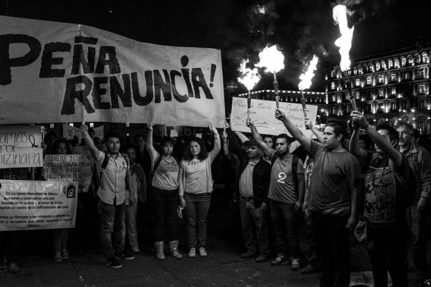 People rally on the streets of México City on November 5, 2014 demanding  an explanation from the government for what happened to the 43 students that went missing on September 26, 2014. The students attended the Raúl Isidro Burgos Rural teachers college of Ayotzinapa in Iguala Guerrero.Allegedly corrupt police in Iguala  worked for the Guerreros Unidos drug gang, which authorities charge had ties to the former mayor of Iguala, Jose Luis Abarca, and his wife, Maria de los Angeles Pineda.