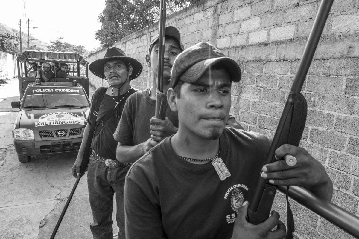 Members of a local militia in Guerrero look for the missing students. While searching for the missing students, other mass graves were uncovered, which highlights the pervasive violence in Guerrero State.