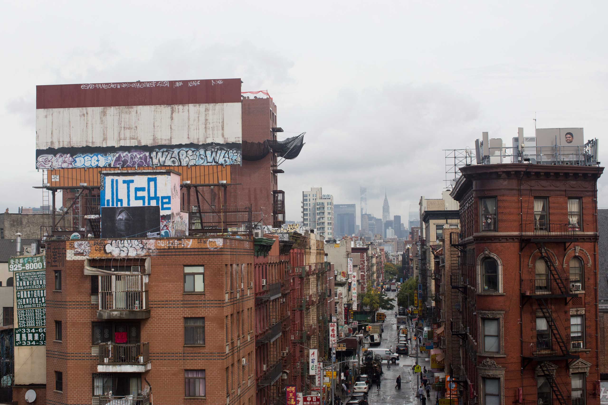 One of Dysturb's photograph on a rooftop in New York (on Division Street in Chinatown). October 16th 2014.
