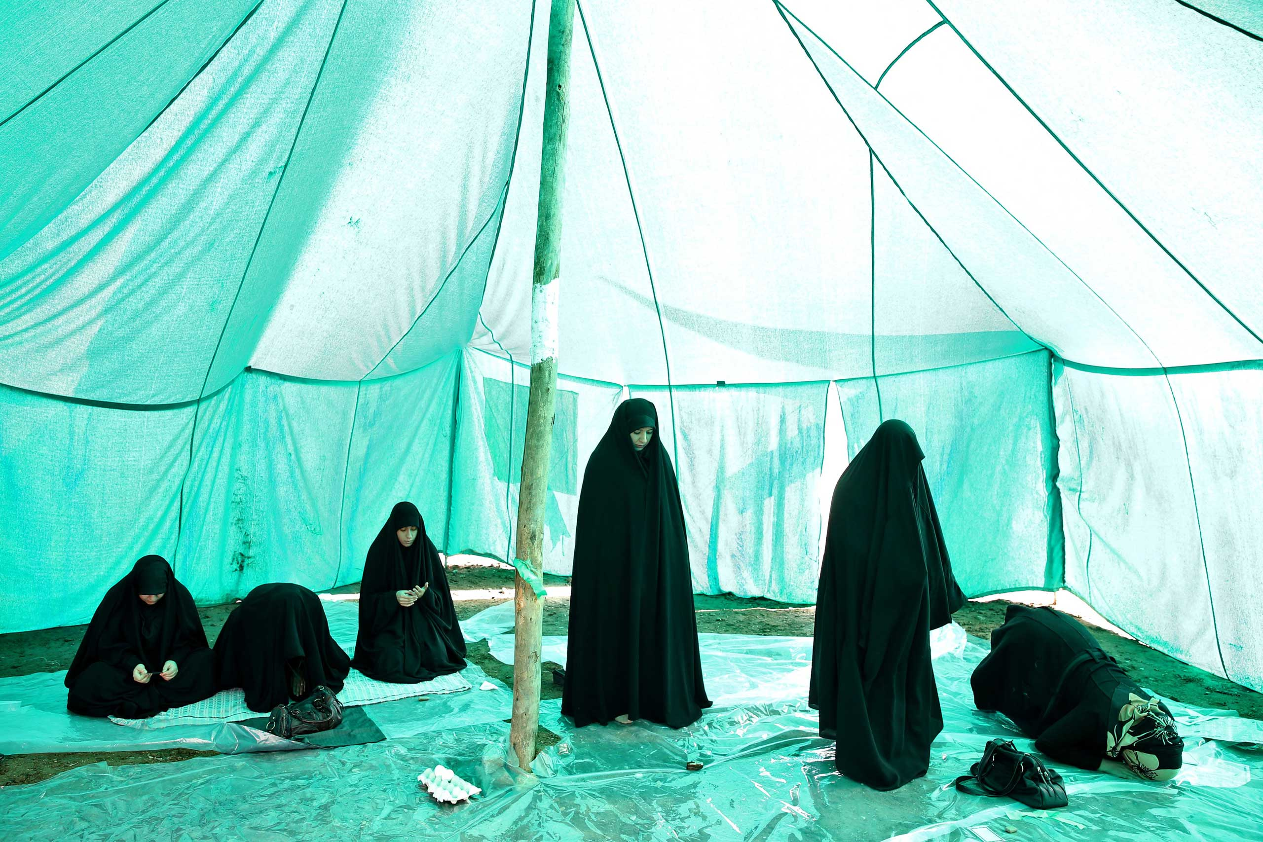 Nov. 4, 2014. Shiite mourners pray while attending Ashoura day rituals commemorating the death anniversary of Imam Hussein in south of Tehran.