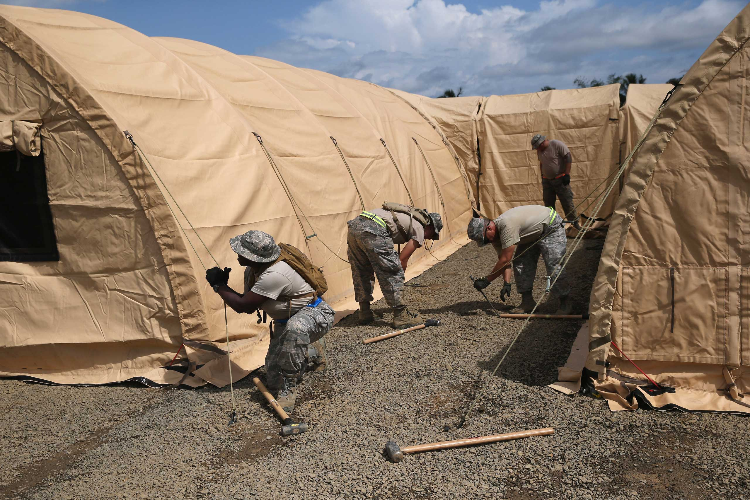 U.S. Air Force personnel put up tents to house a 25-bed U.S.-built hospital for sick Liberian health workers as part in Operation United Assistance on Oct. 9, 2014 in Monrovia, Liberia.