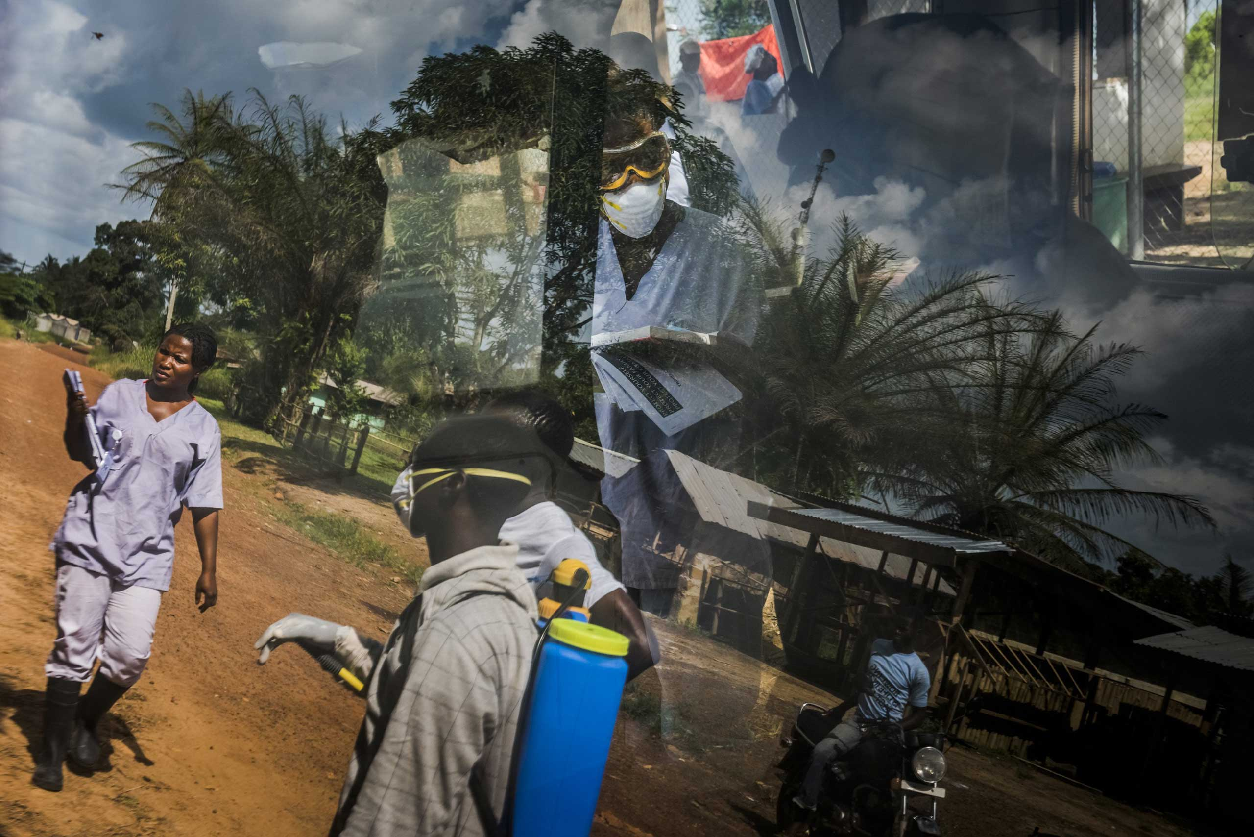 The reflection on an ambulance window of an Ebola outreach team from the Bong County International Medical Corps treatment unit in Kakata, Liberia, Oct. 24, 2014.