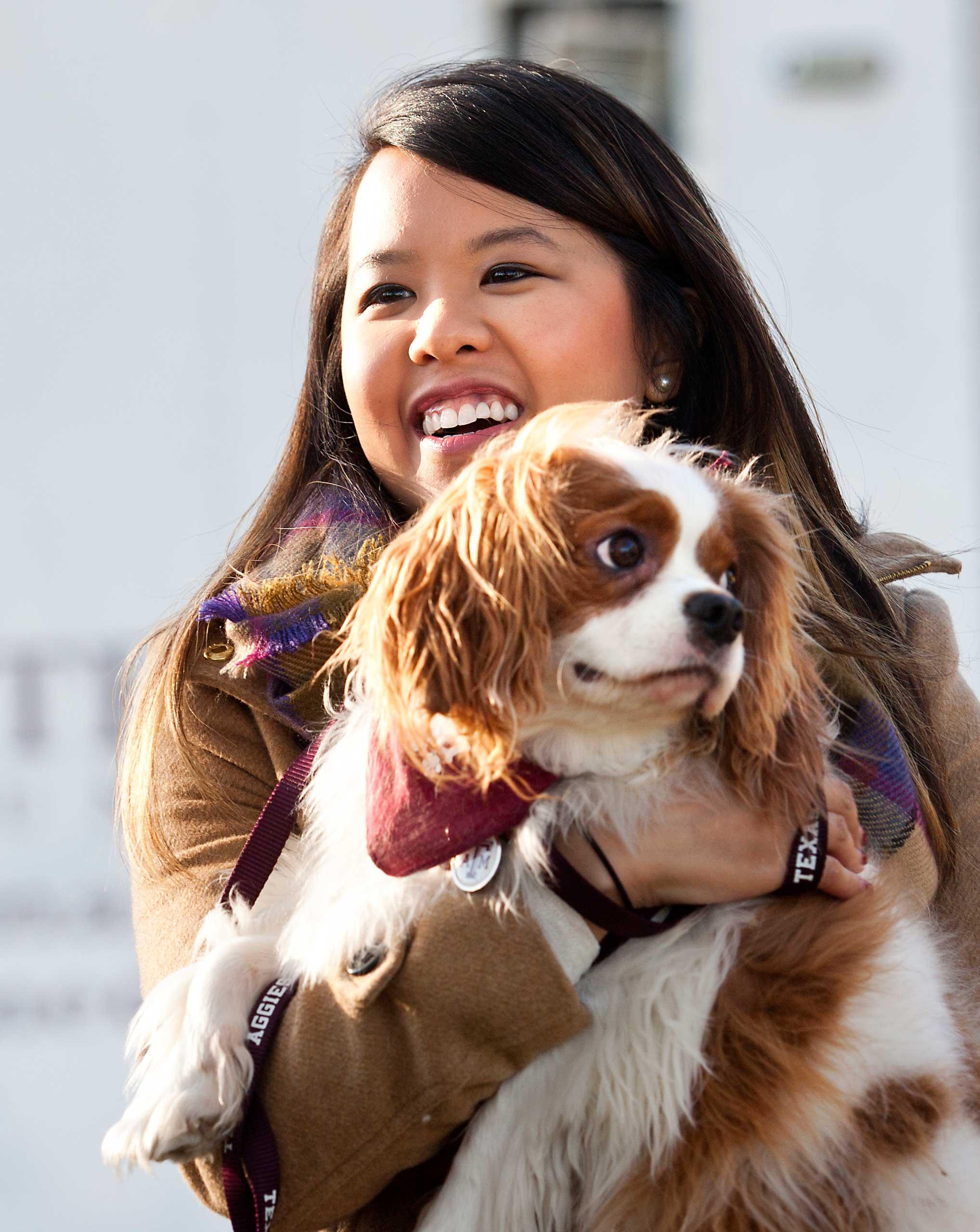 Nina Pham holds up her dog Bentley, at Hensley Field in Grand Prairie, Texas, Nov. 1, 2014.