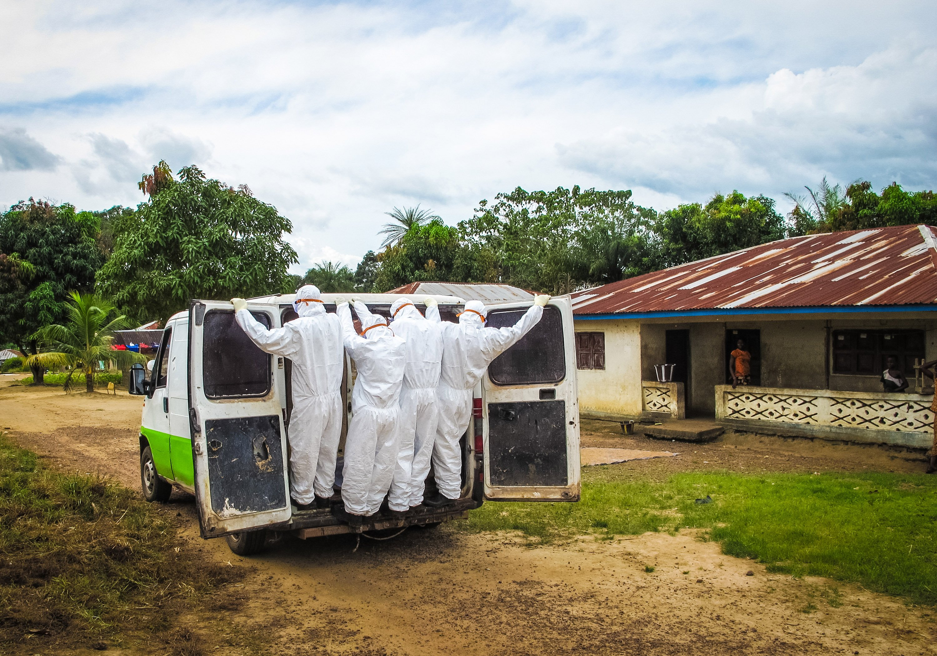 Health workers transport the body of a person suspected to have died of the Ebola virus in Port Loko Community, situated on the outskirts of Freetown, Sierra Leoneon Oct. 21, 2014.
