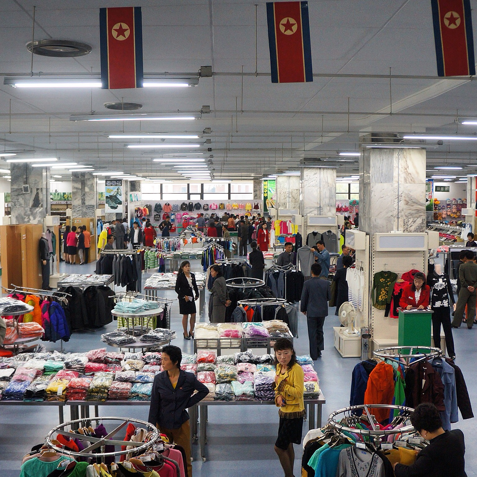North Koreans shop in the clothing section of Kwangbok Market in Pyongyang. Koreans love their fashion, even in the North.