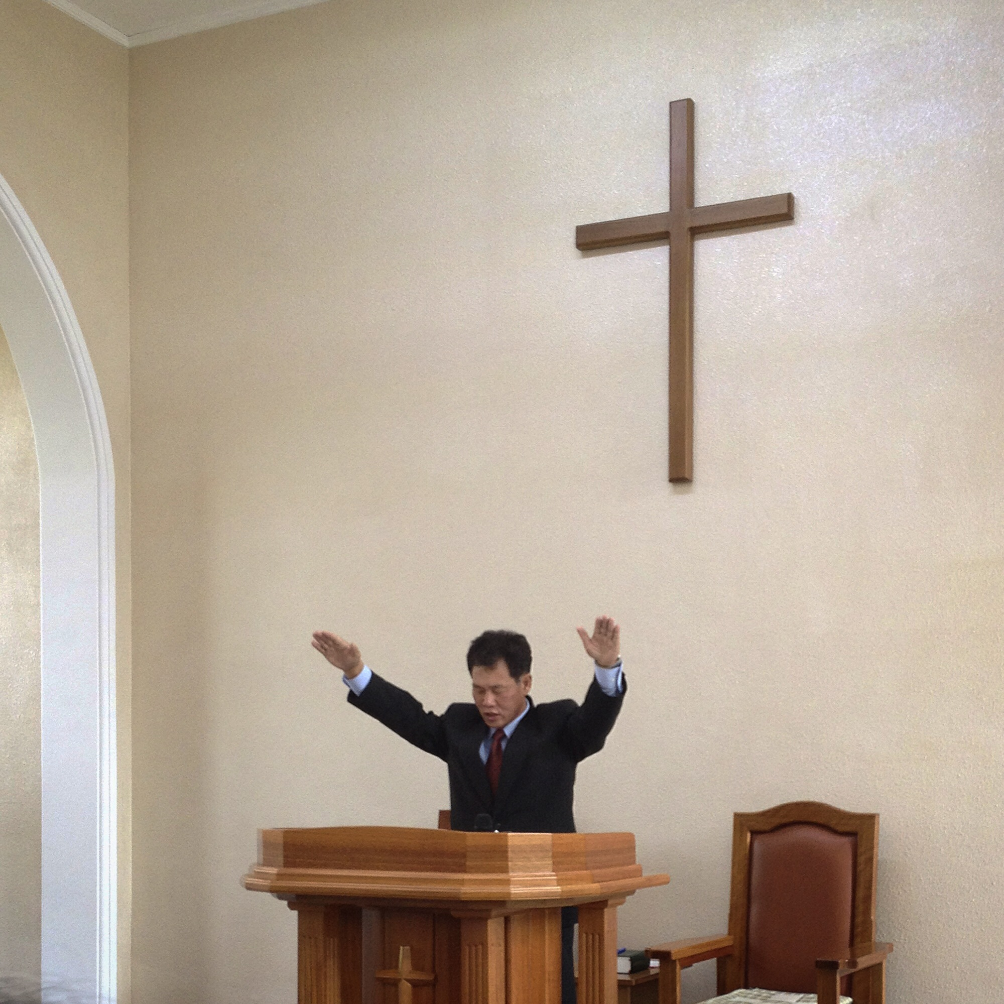 The vicar of the Chilgol Church (the smaller of the two protestant churches in Pyongyang), blesses the congregation at the end of his Sunday sermon. On this occasion there were maybe 20 local worshippers, plus around a dozen member of the choir. The church is located next to the birthplace of Kim Il Sung's mother, who was known to be a churchgoer herself.