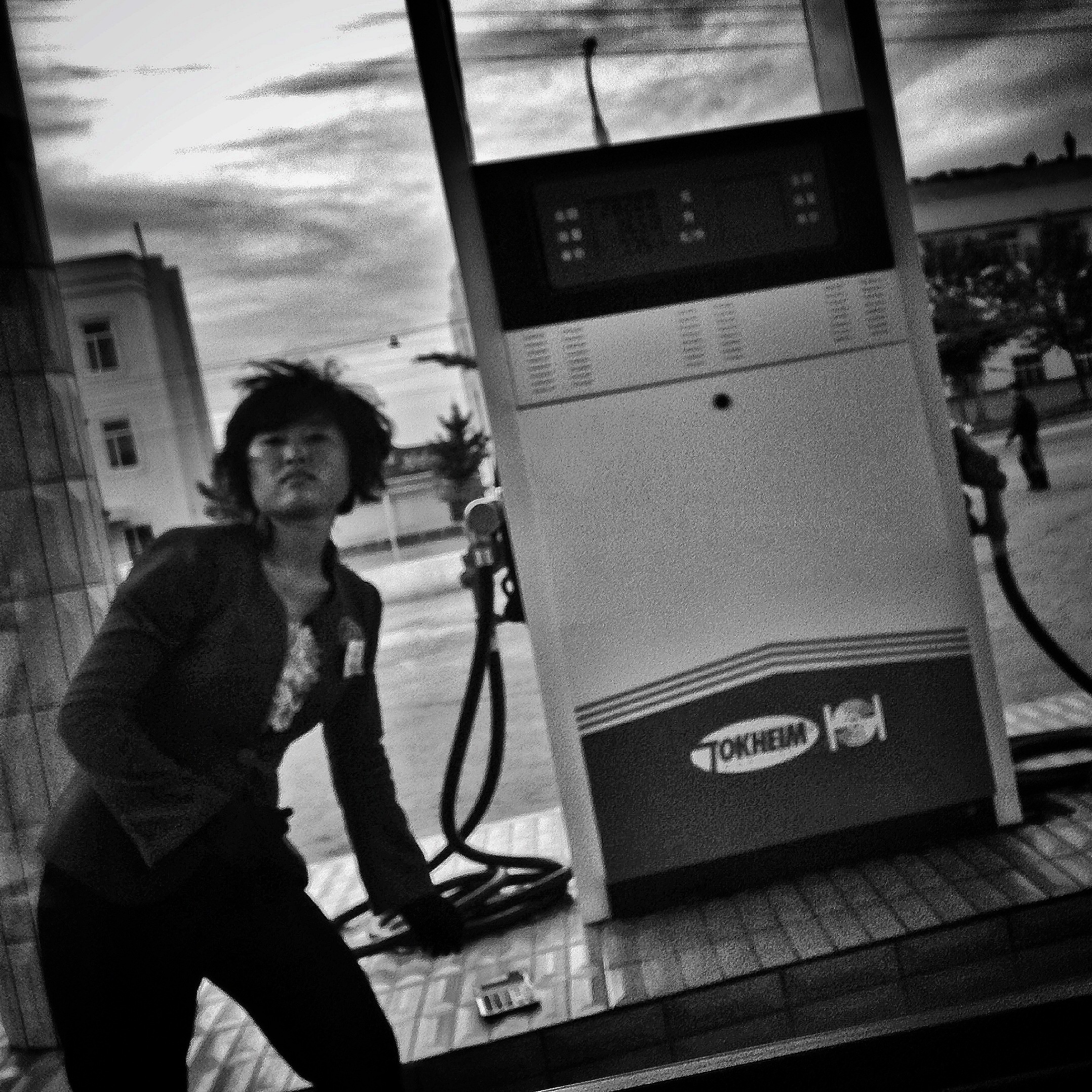 A North Korean gas station attendant works at a gas pump in the town of Hamhung.