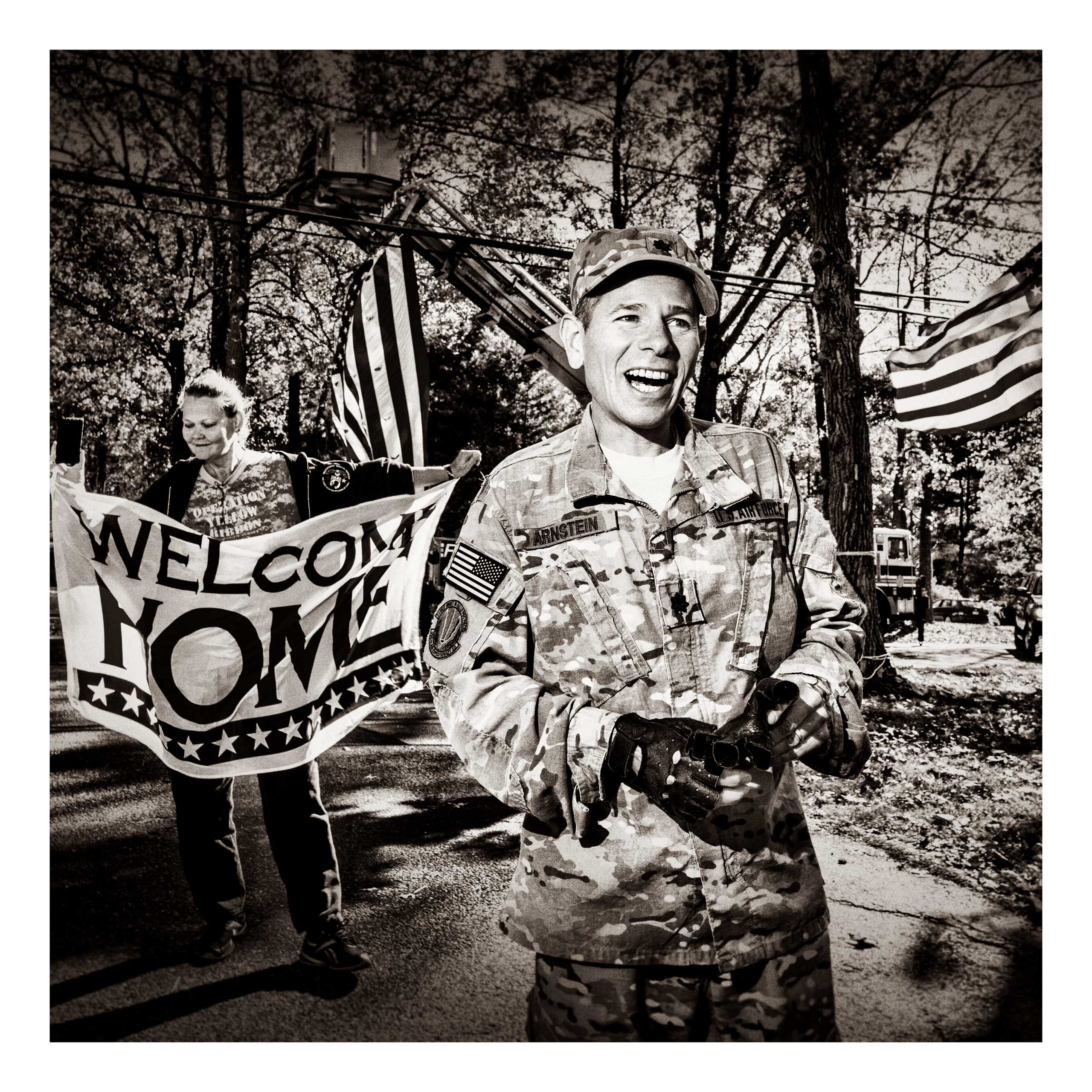 Lt Col. Jesse Arnstein smiles at a welcome home party in the American Legion in Cherry Hill, N.J., after returning from deployment in Afghanistan.
