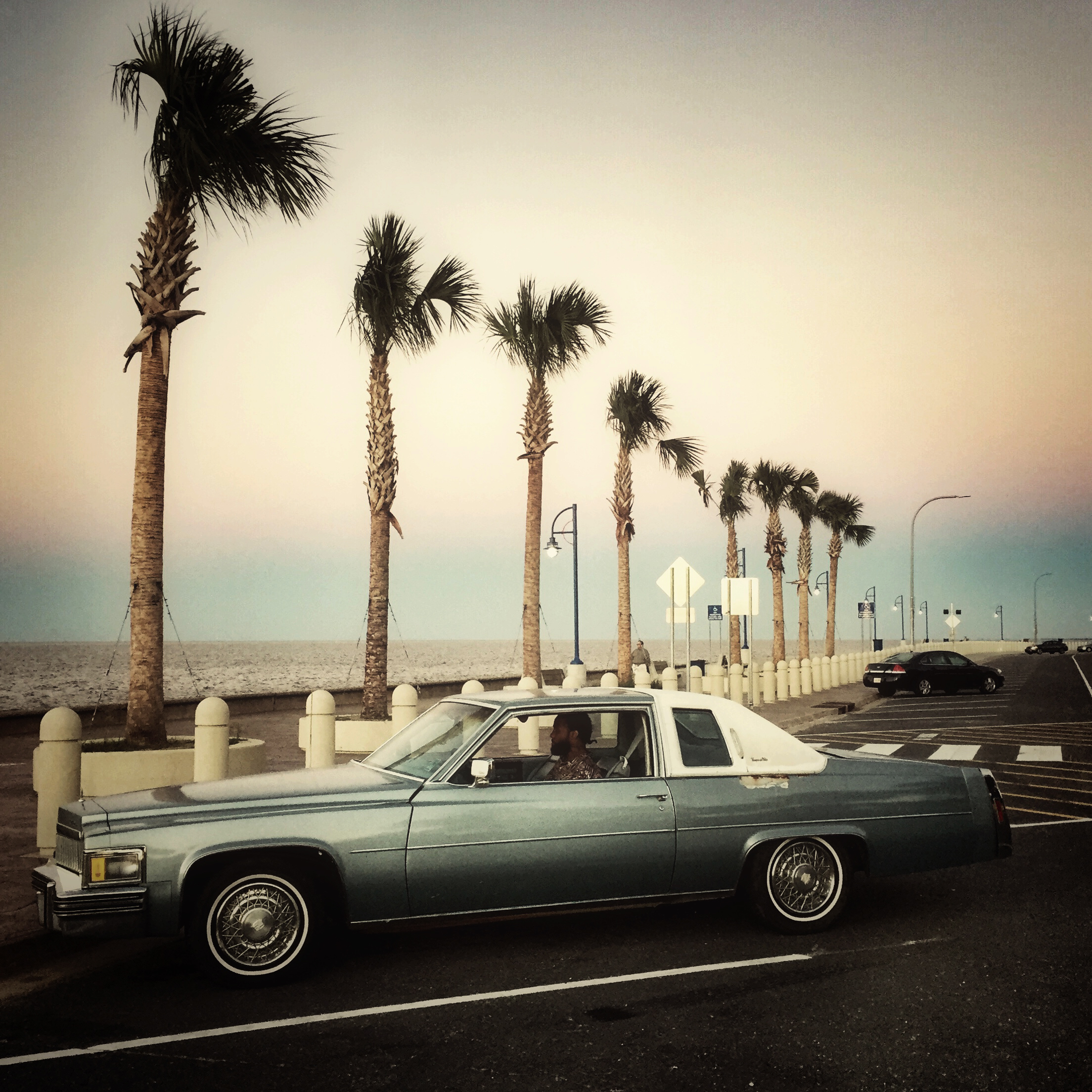 """Jones sits by Lake Shore Drive in New Orleans, Louisiana in a 1978 Cadillac Coupe Deville he bought for a restoration project. """"I love working with my hands,  he says."""