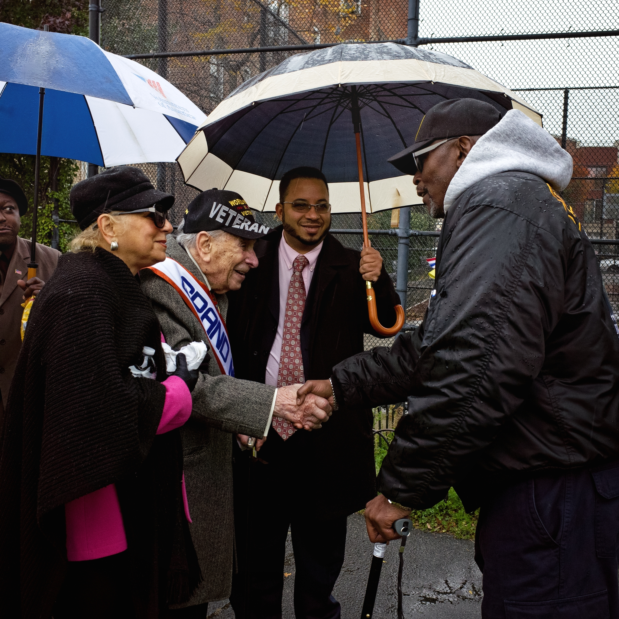 Joe Binder, a 104 year-old World War II veteran, greets other war vets during the and the 2014 Bronx Veterans Day Parade. He was the Grand Marshall.