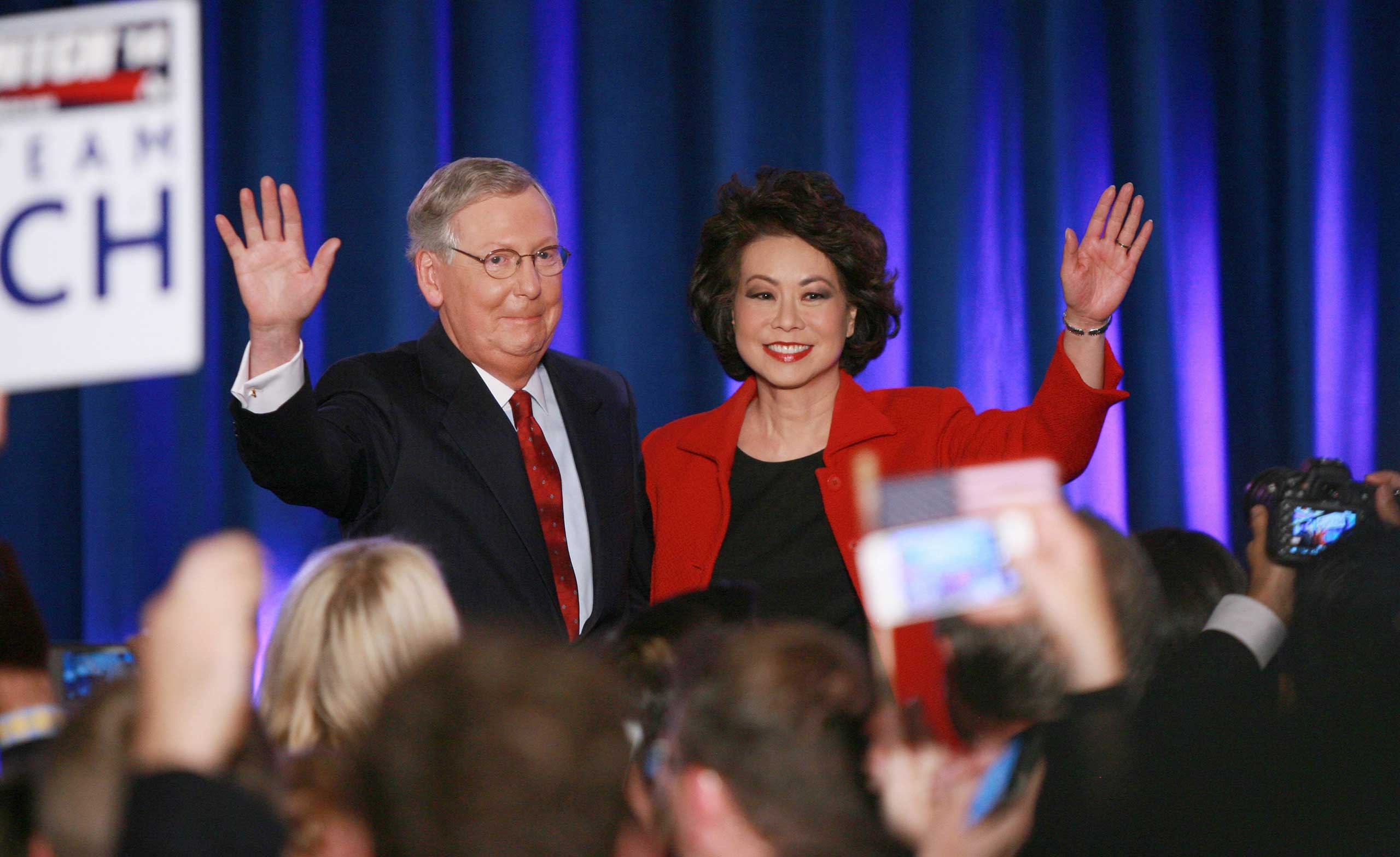 US Sen. Mitch McConnell, Republican from Kentucky, waves to supporters with his wife Elaine Chao during his victory celebration at the Marriott East Hotel in Louisville, Ky. on Nov. 4, 2014.