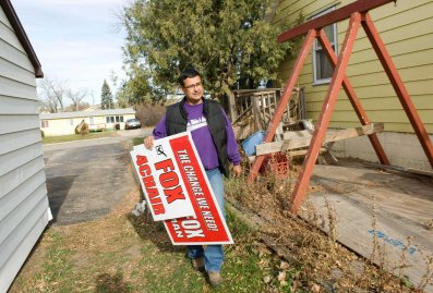 Three Affiliated Tribes council chairman candidate Fox delivers signs to a supporter's house on the Fort Berthold Reservation in North Dakota