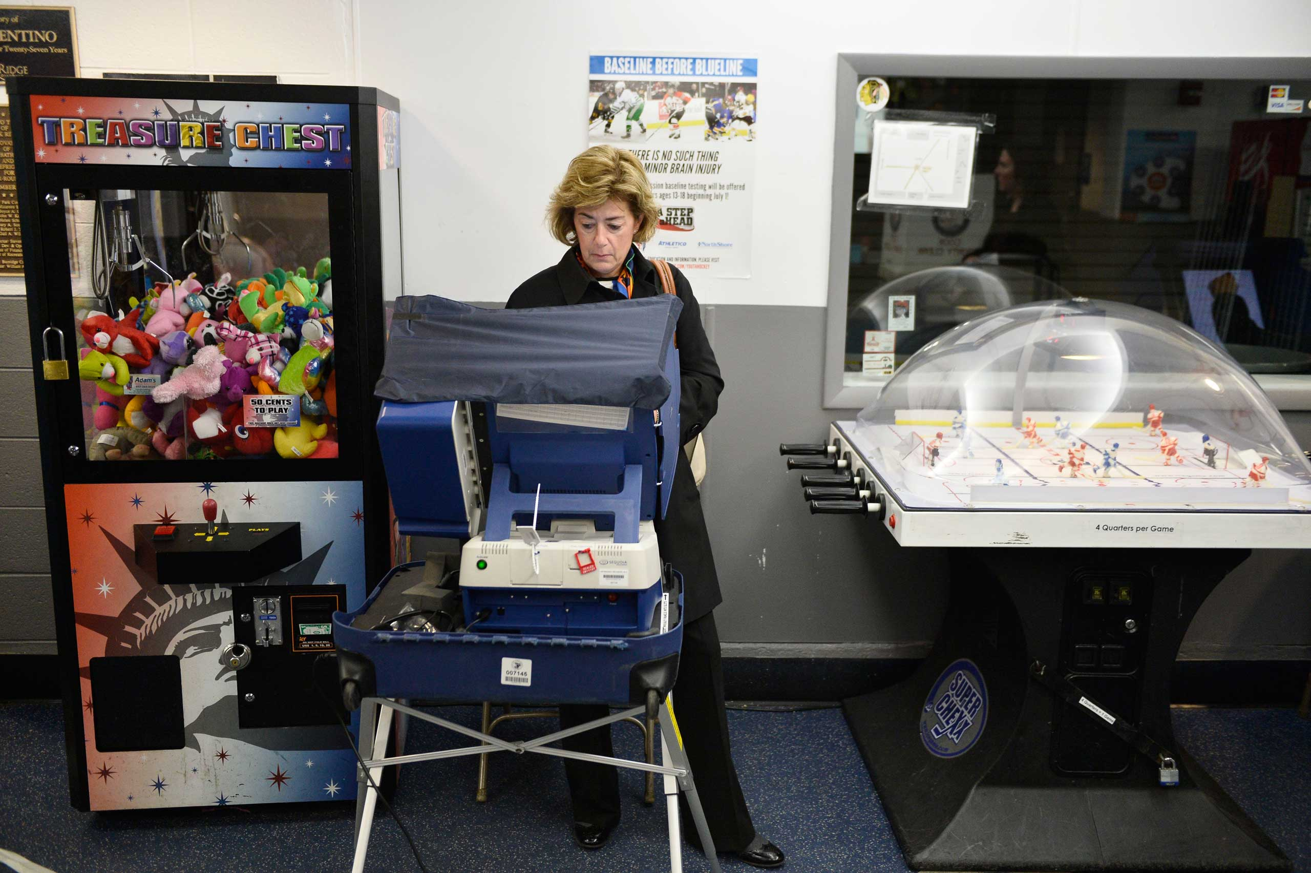Sandy Anderson votes at Oakton Ice Arena in Park Ridge, Ill. on Nov. 4, 2014.
