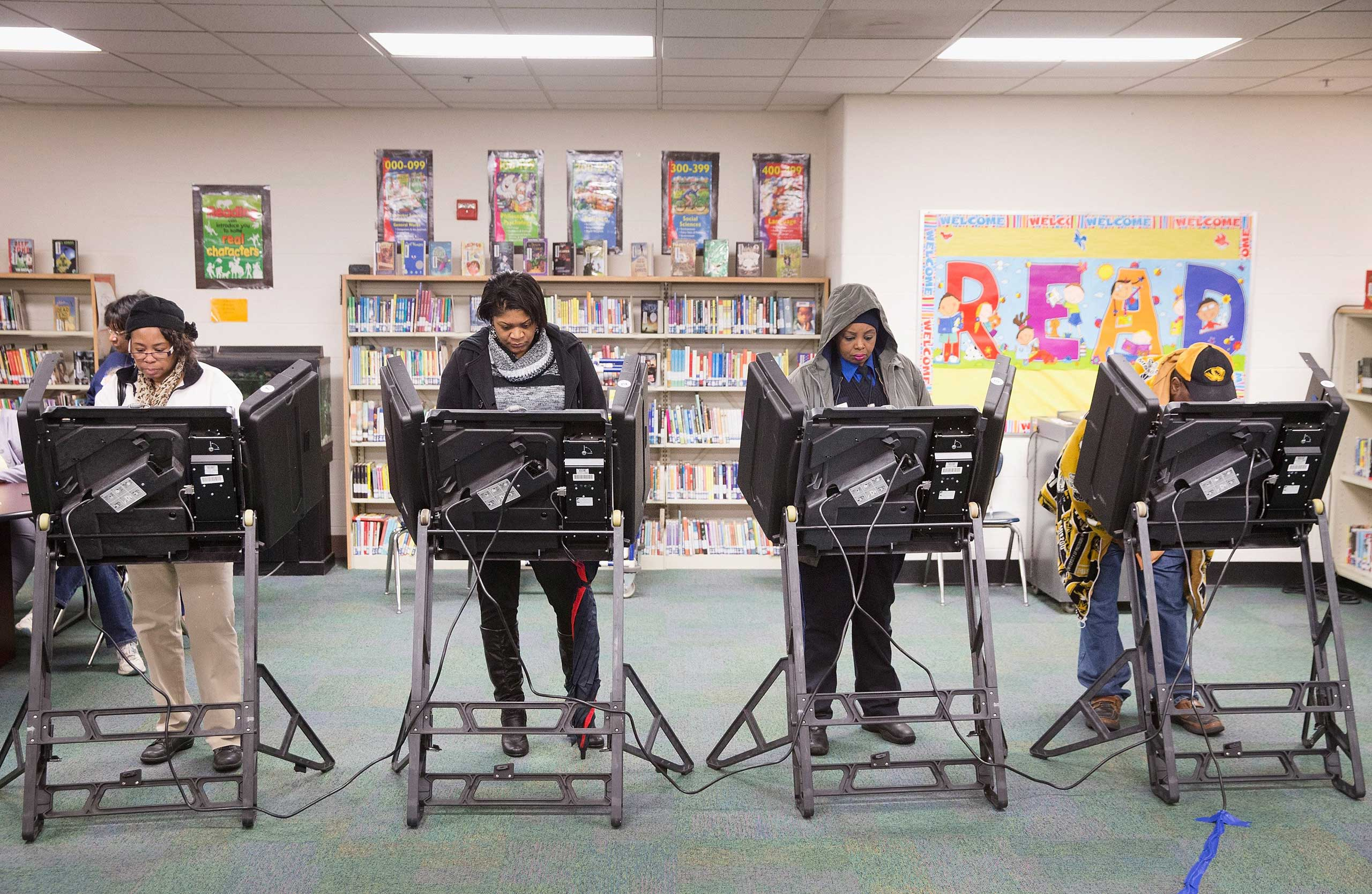 Residents cast their votes at a polling place in Ferguson, Mo. on Nov. 4, 2014.