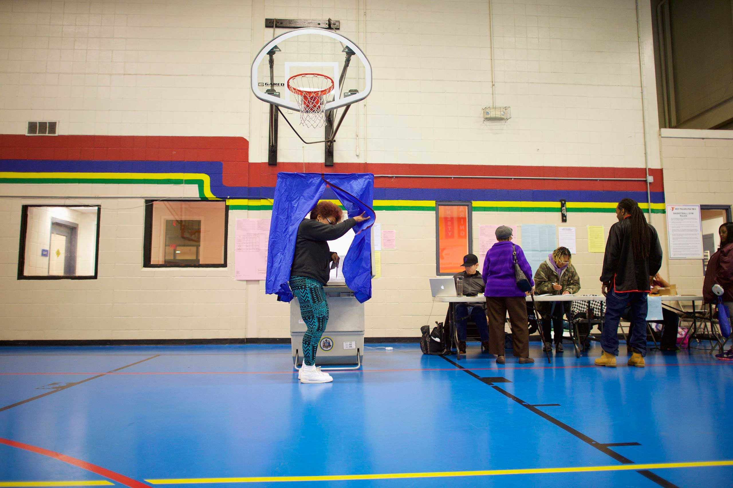 Deborah Brown, 60, emerges from the voting booth after casting her ballot at the West Philadelphia YMCA in Philadelphia on Nov. 4, 2014.