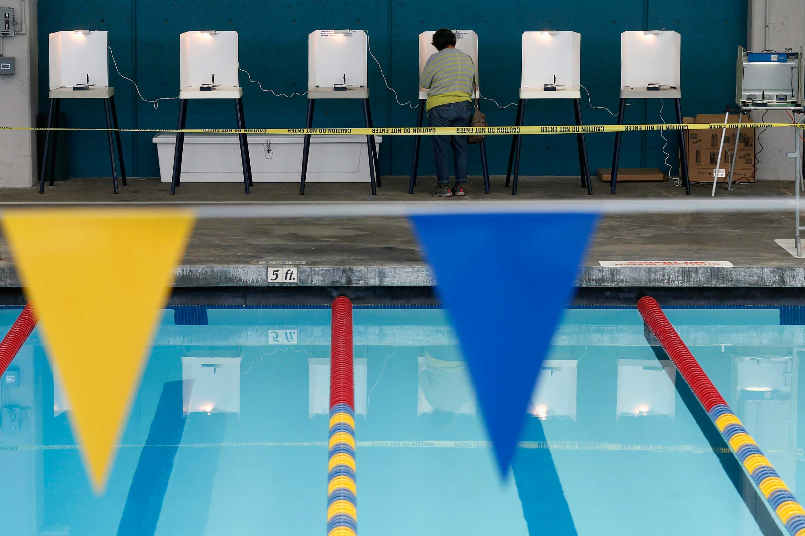 A woman fills out her ballot at a polling place at a swimming pool in Los Angeles on Nov. 4, 2014.