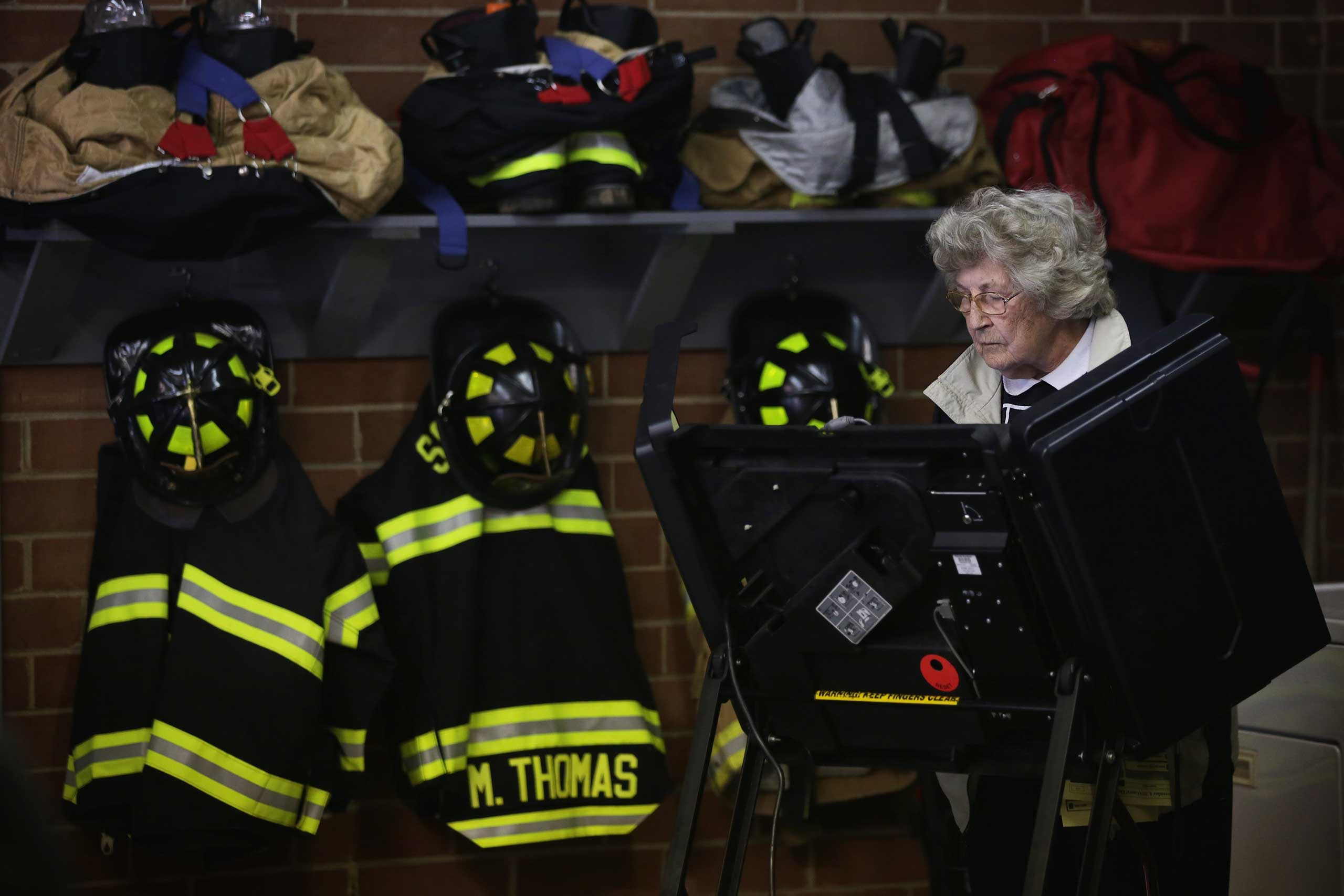A voter casts her ballot at a fire station in Climax, N.C. on Nov. 4, 2014.