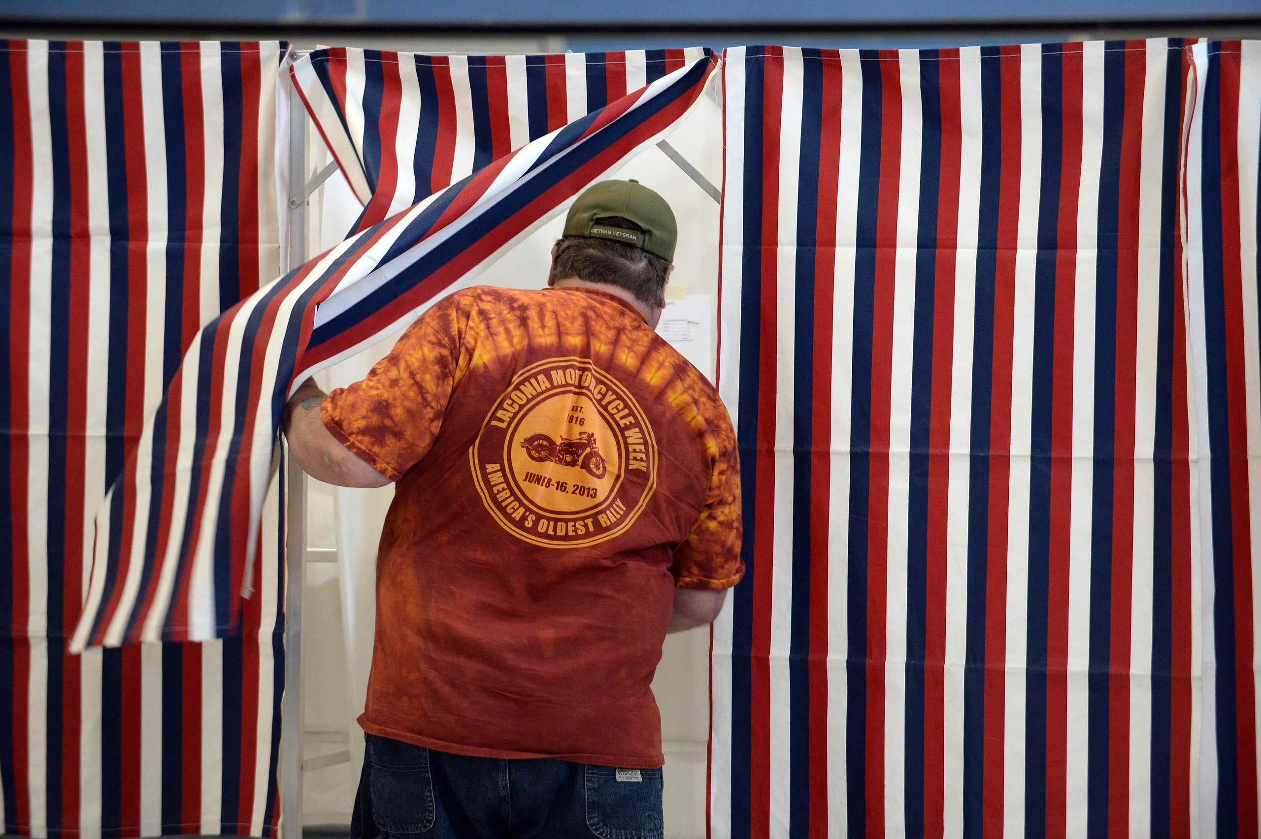 A voter enters the voting booth at Bishop Leo E. O'Neil Youth Center in Manchester, N.H. on Nov. 4, 2014.