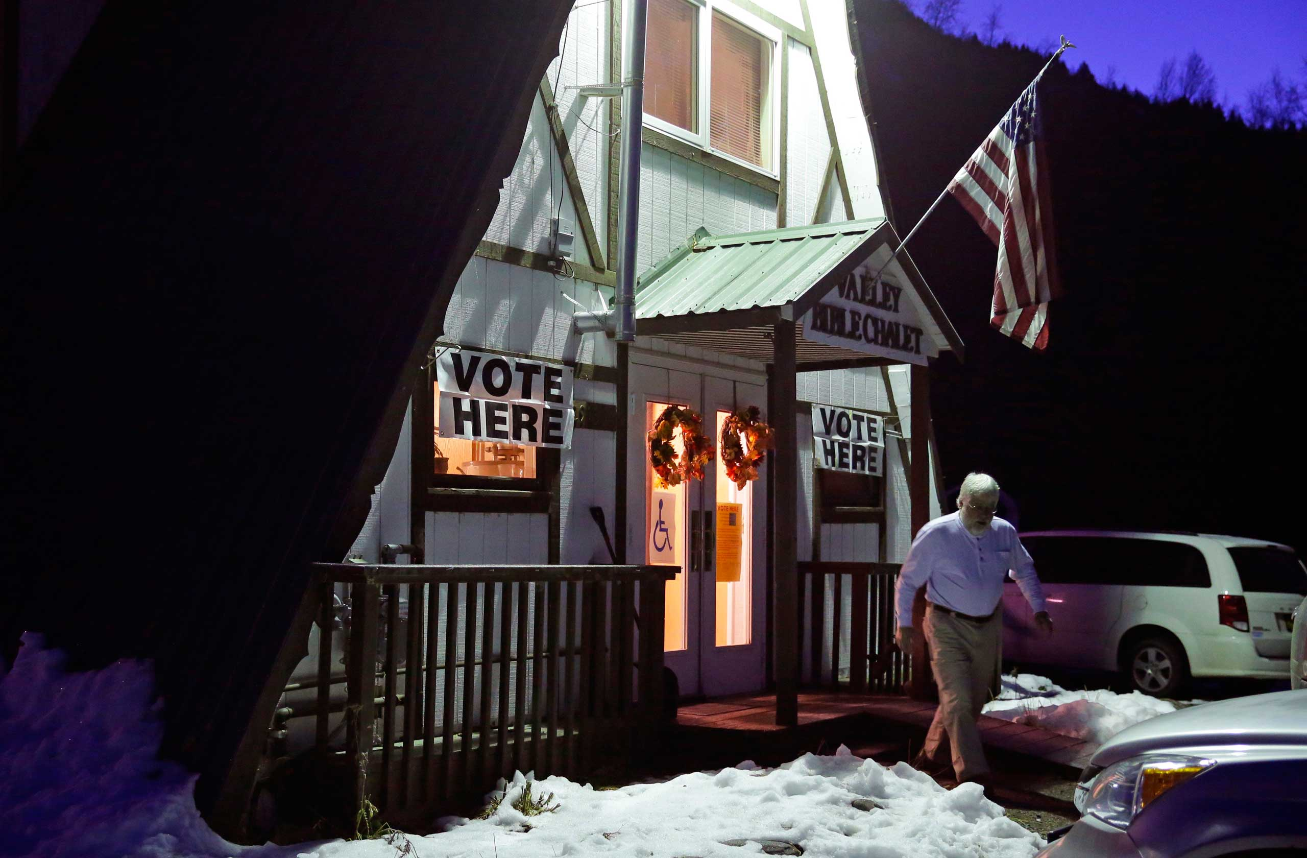 A voter leaves the Valley Bible Chalet polling location in Indian, Alaska on Nov. 4, 2014.
