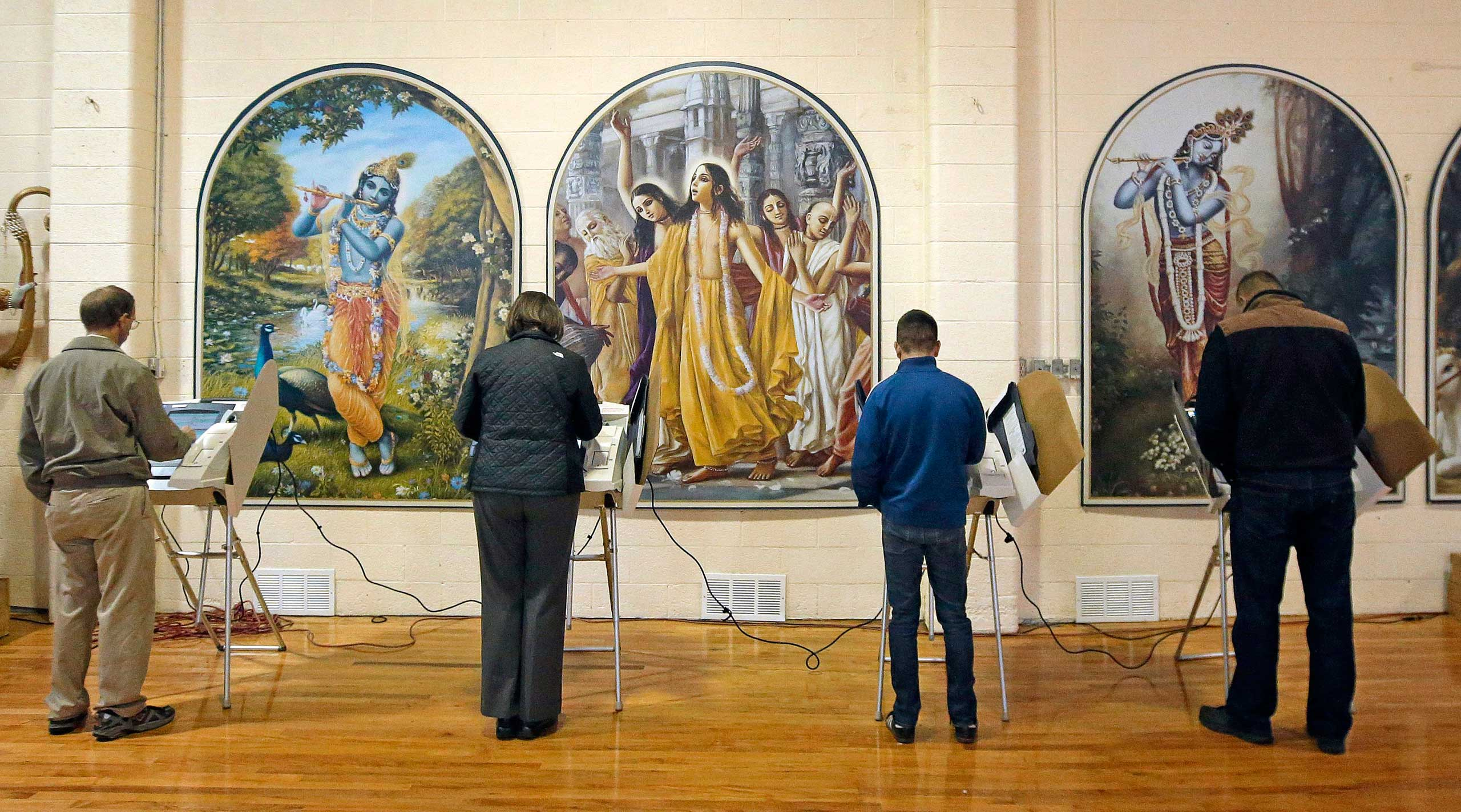 People vote at the polling place in Krishna Temple in Salt Lake City on Nov. 4, 2014.