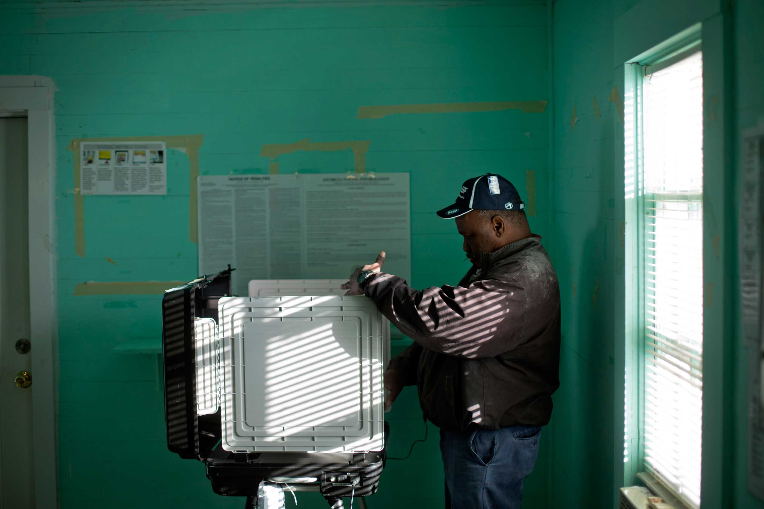 Voter Larry Levatte casts his ballot inside the old Hoggards Mill Courthouse of Baker County in Newton, Ga. on Nov. 4, 2014.