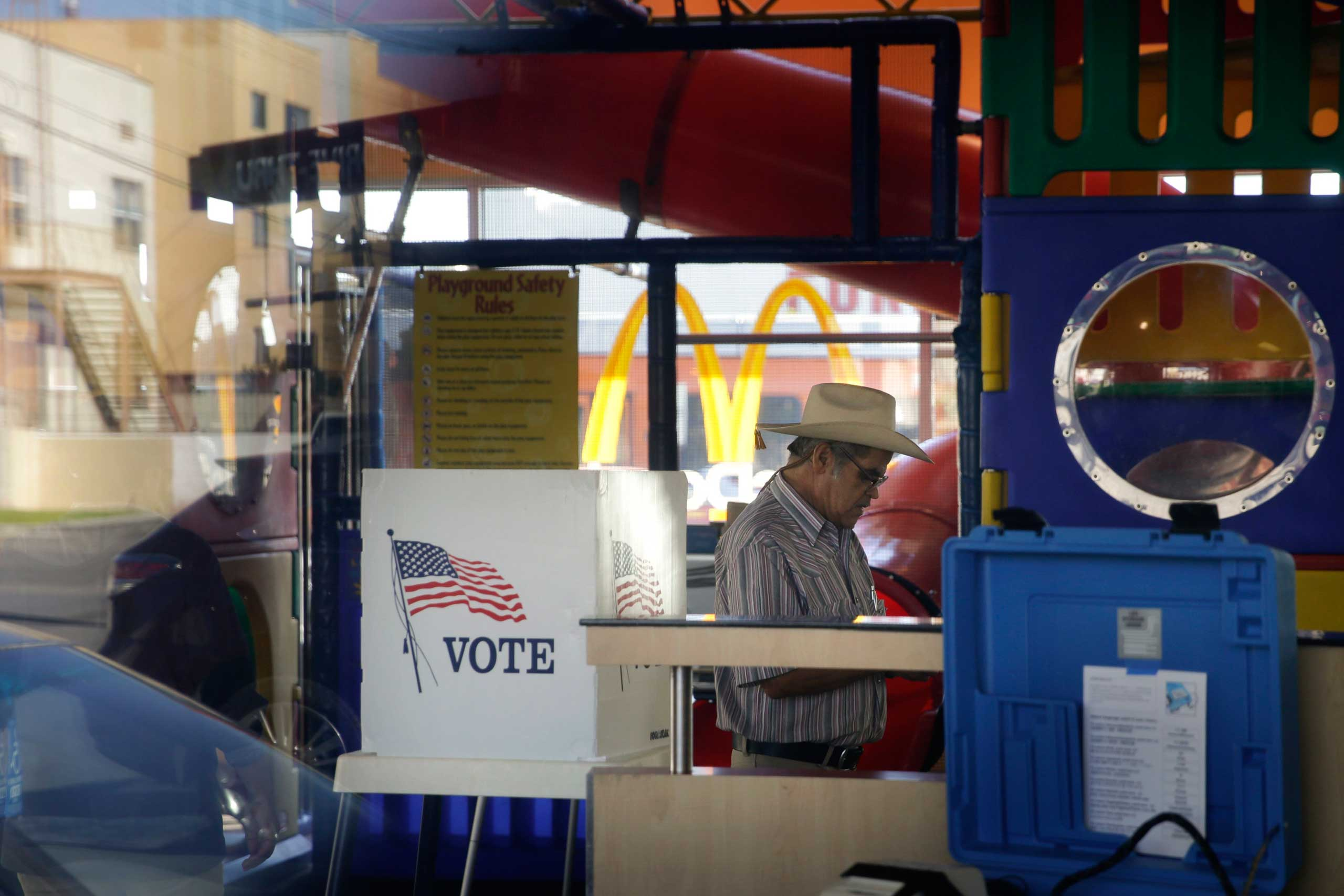 Salvador Ponce, 73, leaves after casting his ballot at a polling place set up in the playground of a McDonald's restaurant in Los Angeles on Nov. 4, 2014.